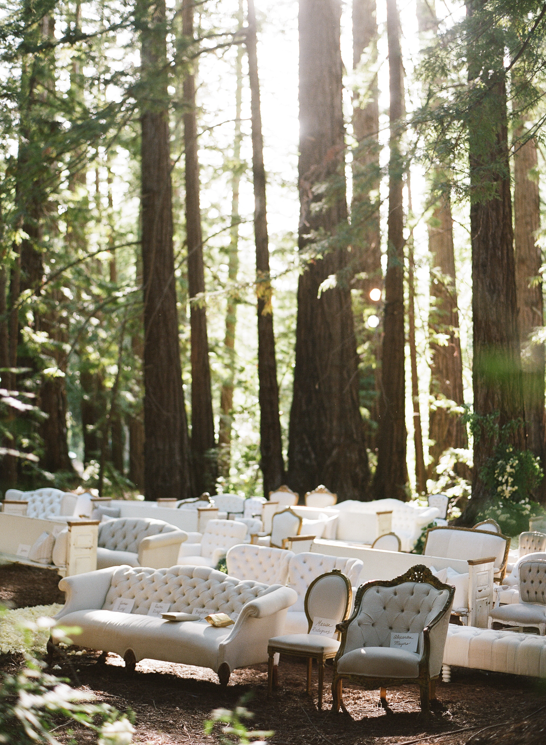 Vintage found furniture arranged for a ceremony among the redwoods in Santa Lucia Preserve; Sylvie Gil Photography
