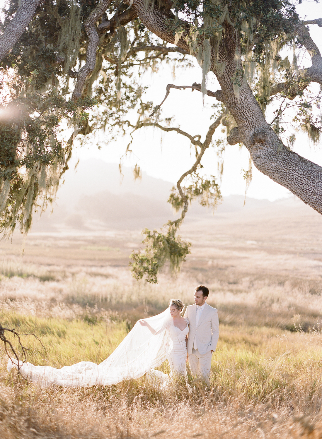 Bride and groom at golden hour in the hills of the Santa Lucia Preserve; Sylvie Gil Photography