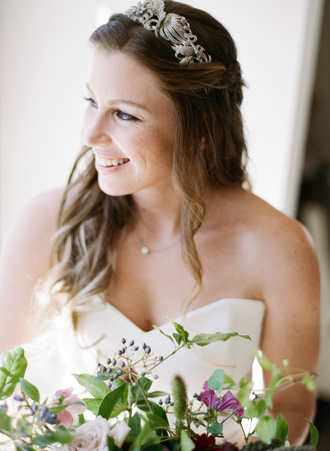 The bride in a sweetheart neckline gown and wrought metal hairpiece; Sylvie Gil Photography