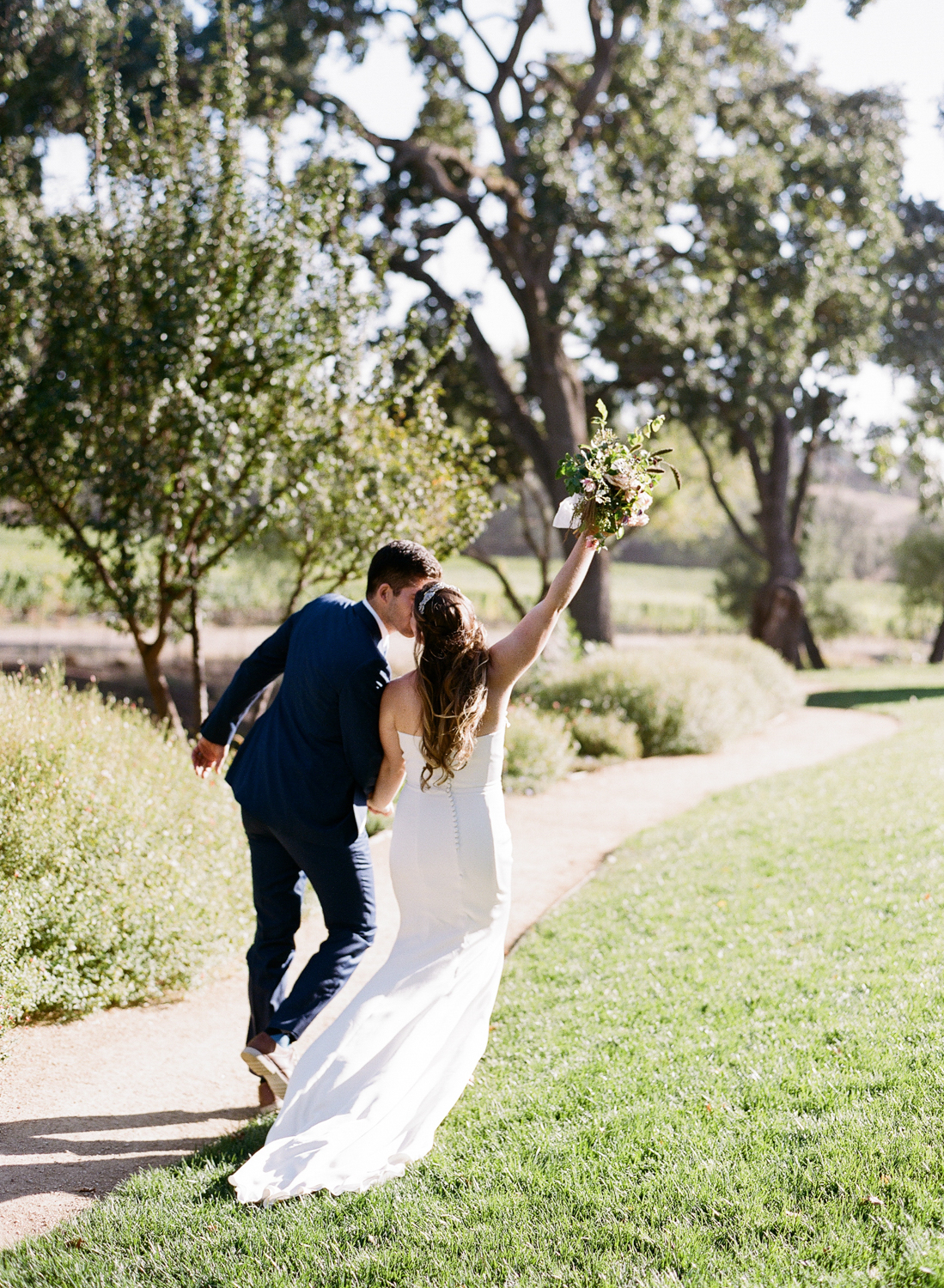 Bride and groom leave their Napa Valley ranch ceremony just married; Sylvie Gil Photography