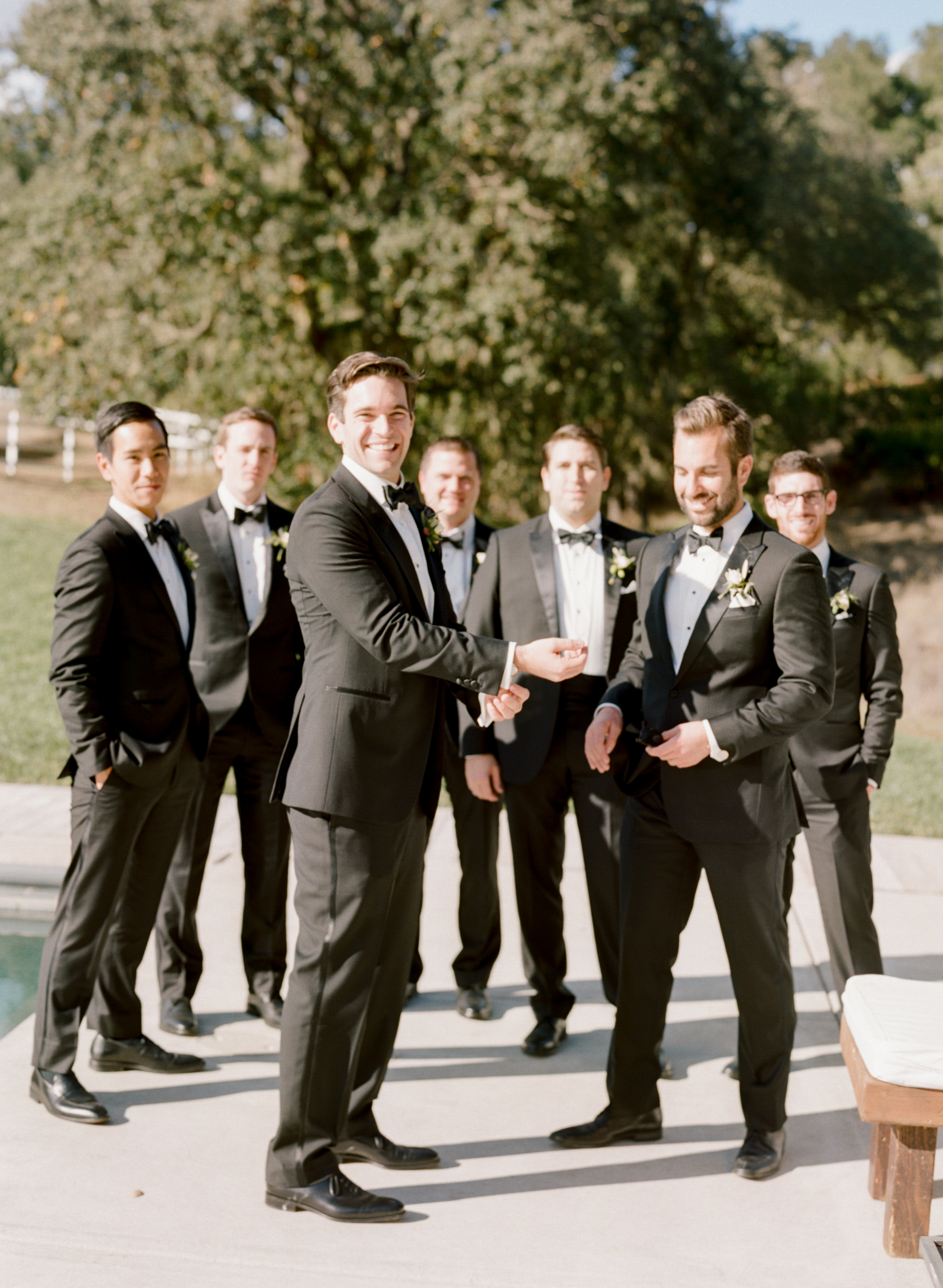 Groom stands with his groomsmen before the wedding ceremony at Durham Ranch; Sylvie Gil Photography