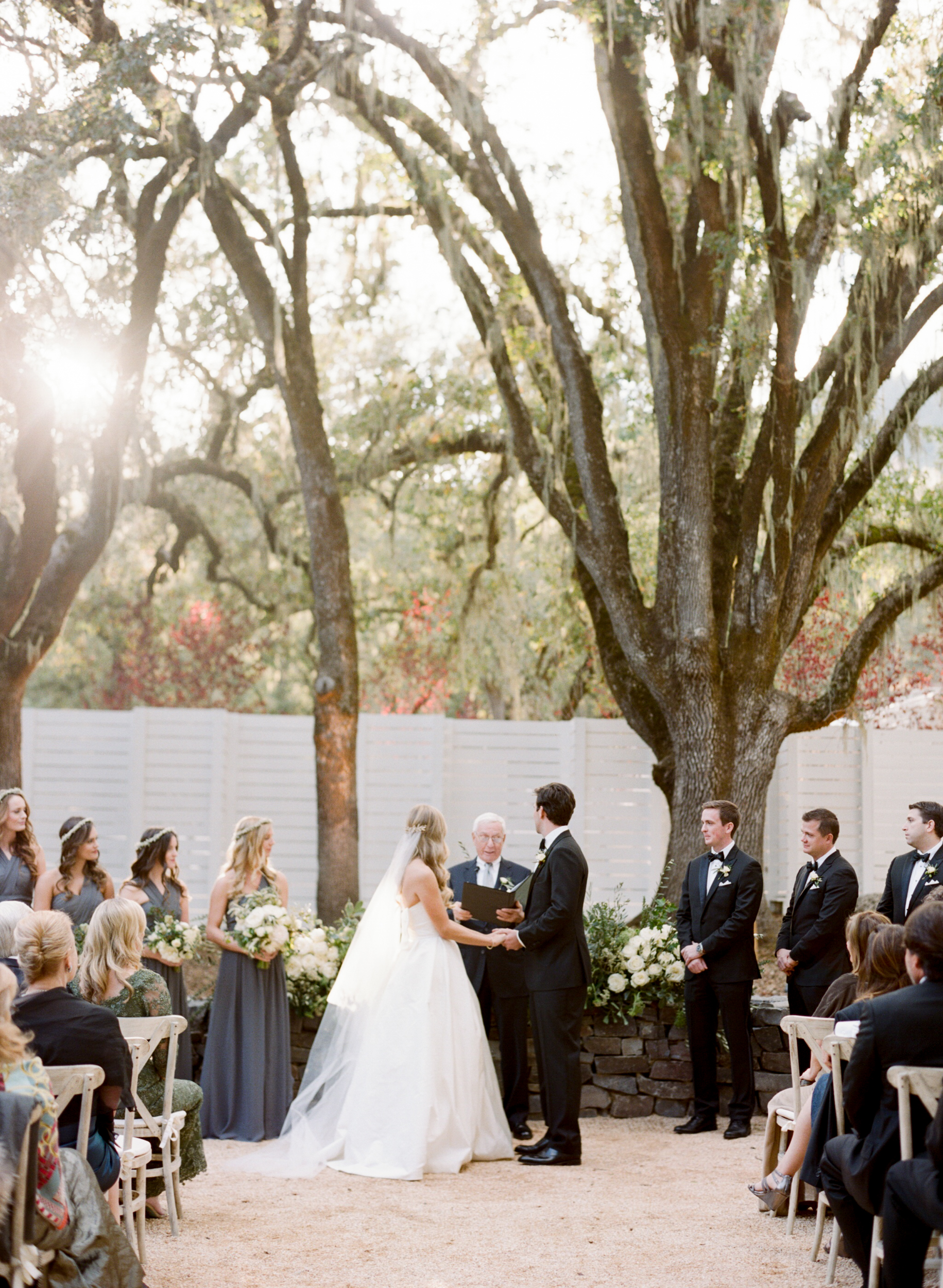 Bride and groom exchange vows at a wedding ceremony at Durham Ranch in St. Helena, California; Sylvie Gil Photography
