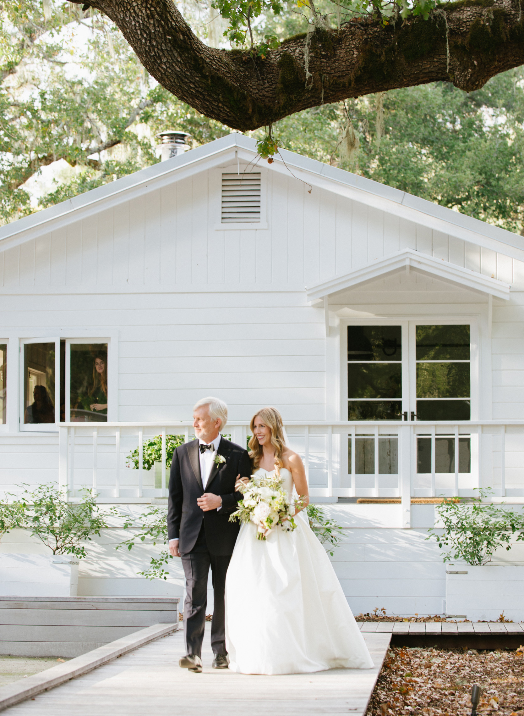 The bride and her father walk up the aisle to the wedding ceremony at Durham Ranch; Sylvie Gil Photography