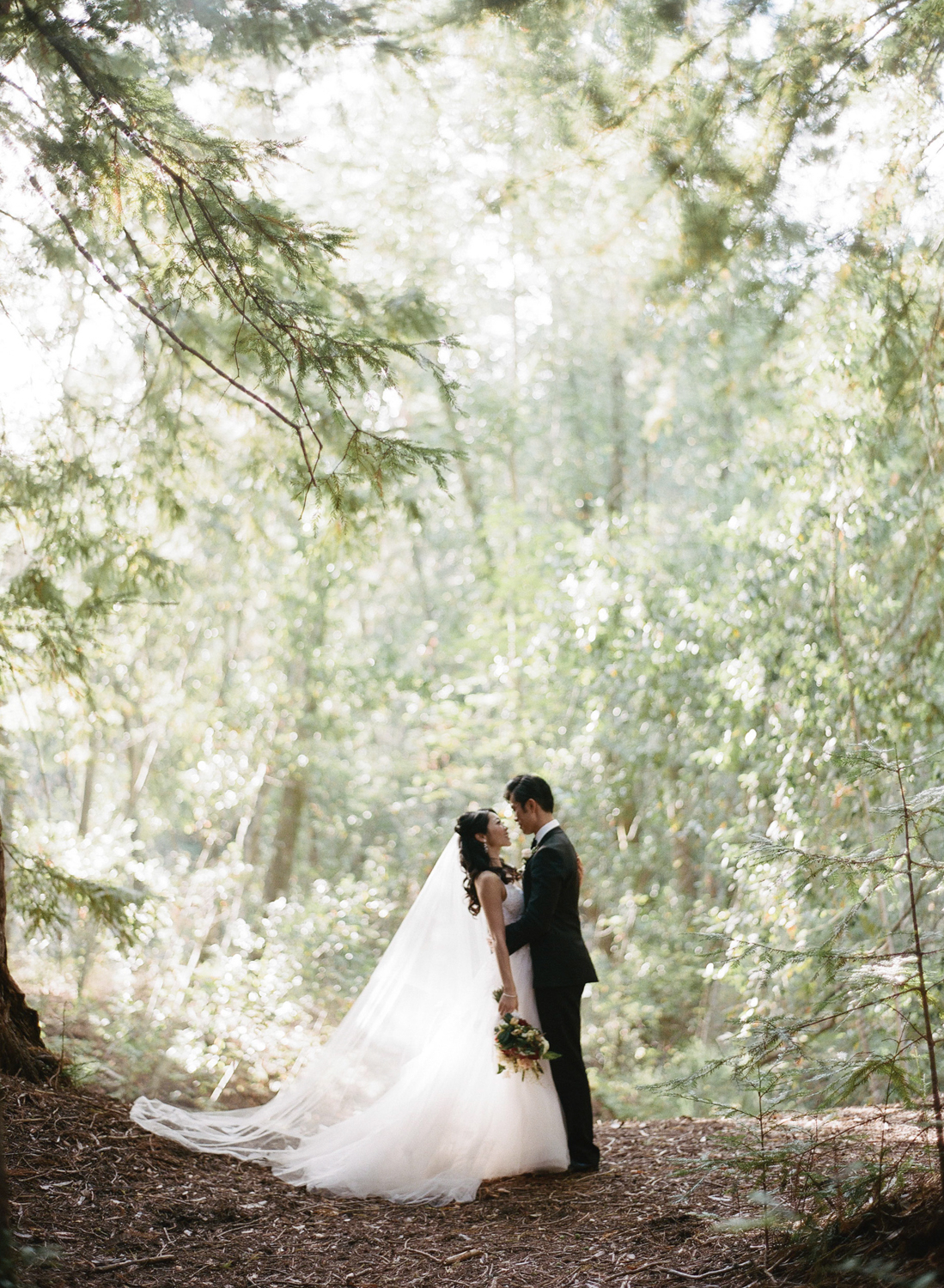 The bride and groom share a moment after their ceremony in the redwoods at Santa Lucia Preserve in Carmel; Sylvie Gil Photography