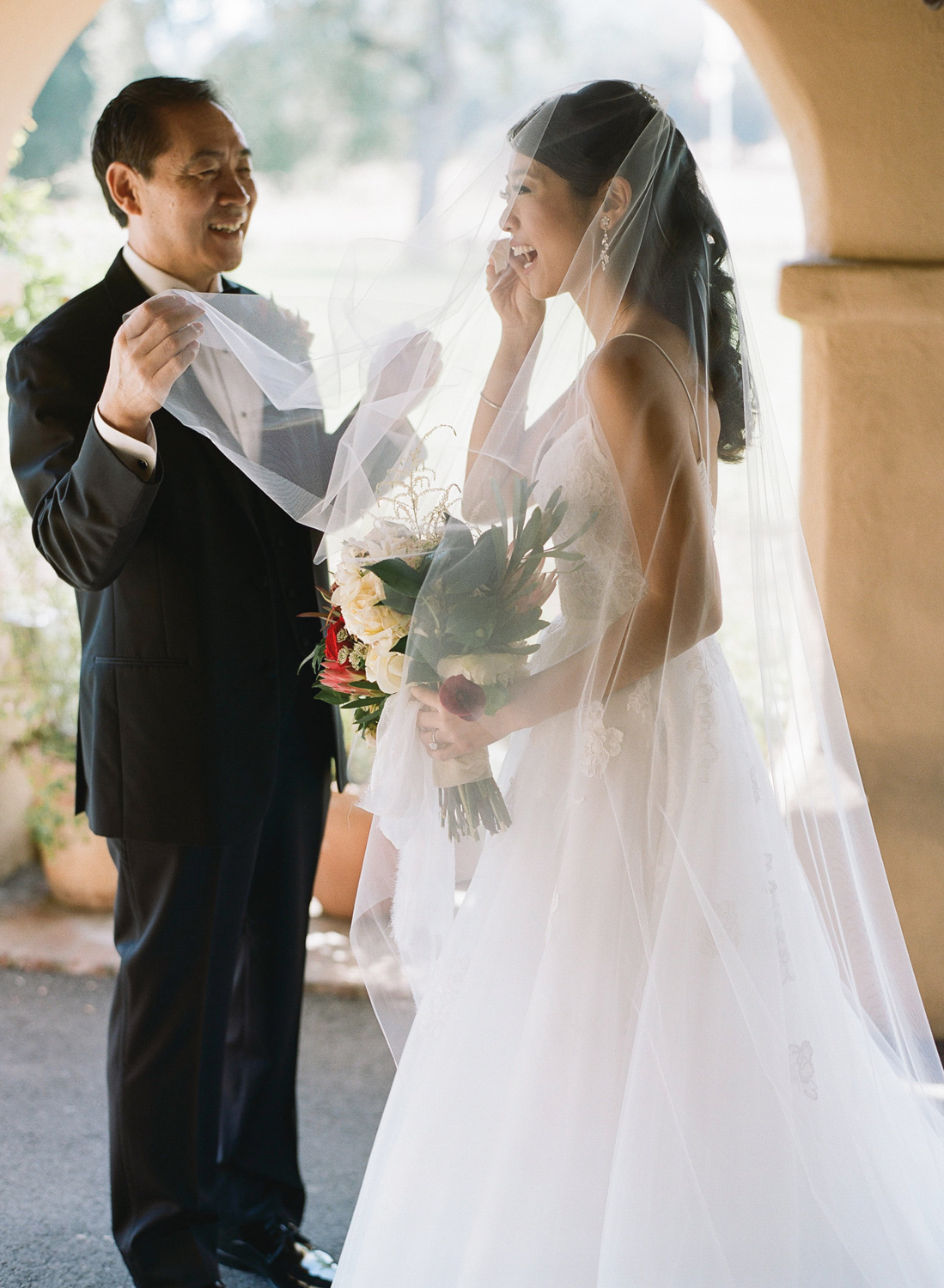 The bride tears up during the first look with her father on the morning of her wedding; Sylvie Gil Photography