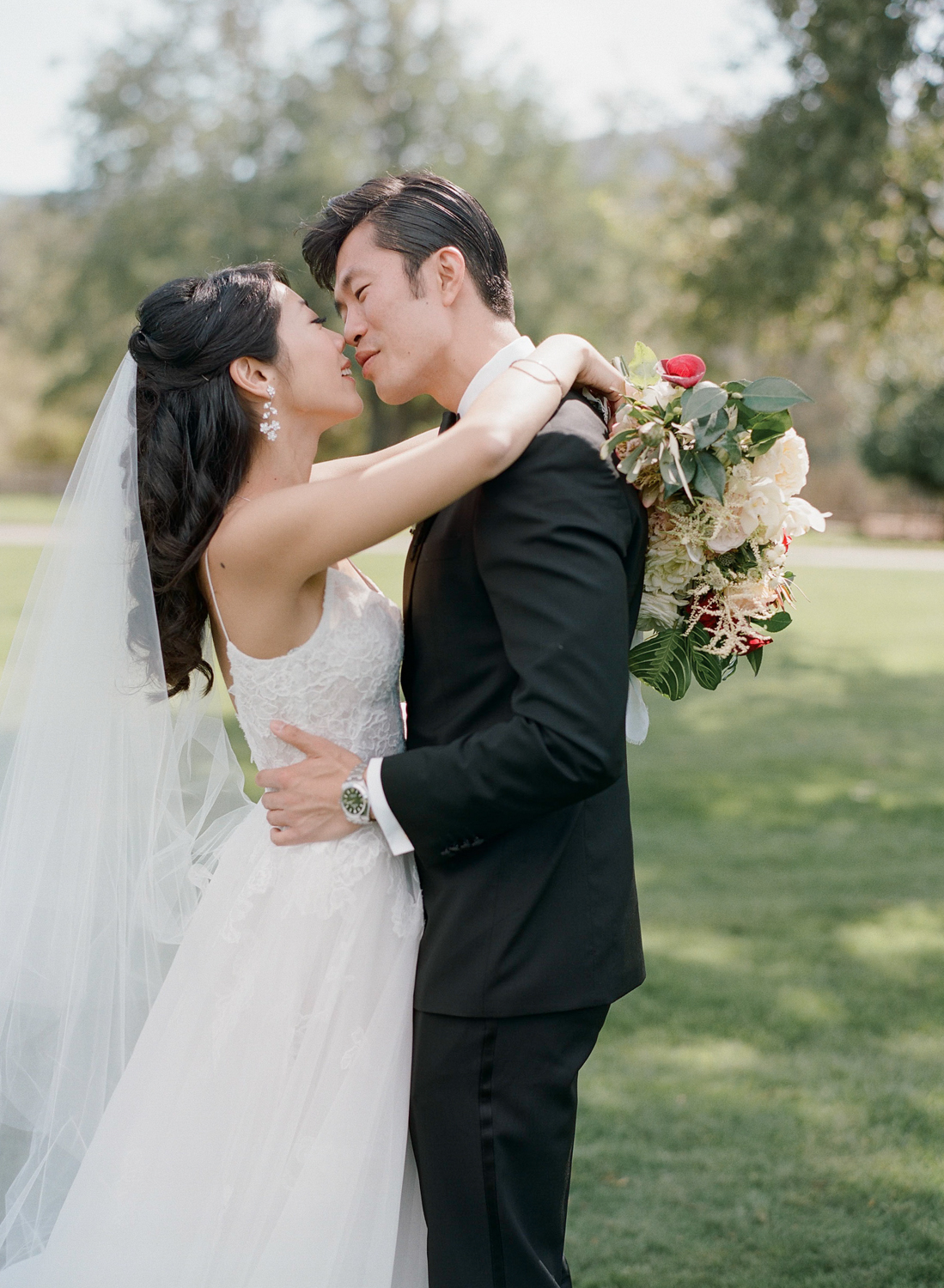 Bride and groom share a romantic moment before their wedding ceremony in Carmel, California; Sylvie Gil Photography