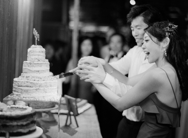 Bride and groom cut their Momofuku wedding cake at their barn wedding reception in Carmel, California; Sylvie Gil Photography