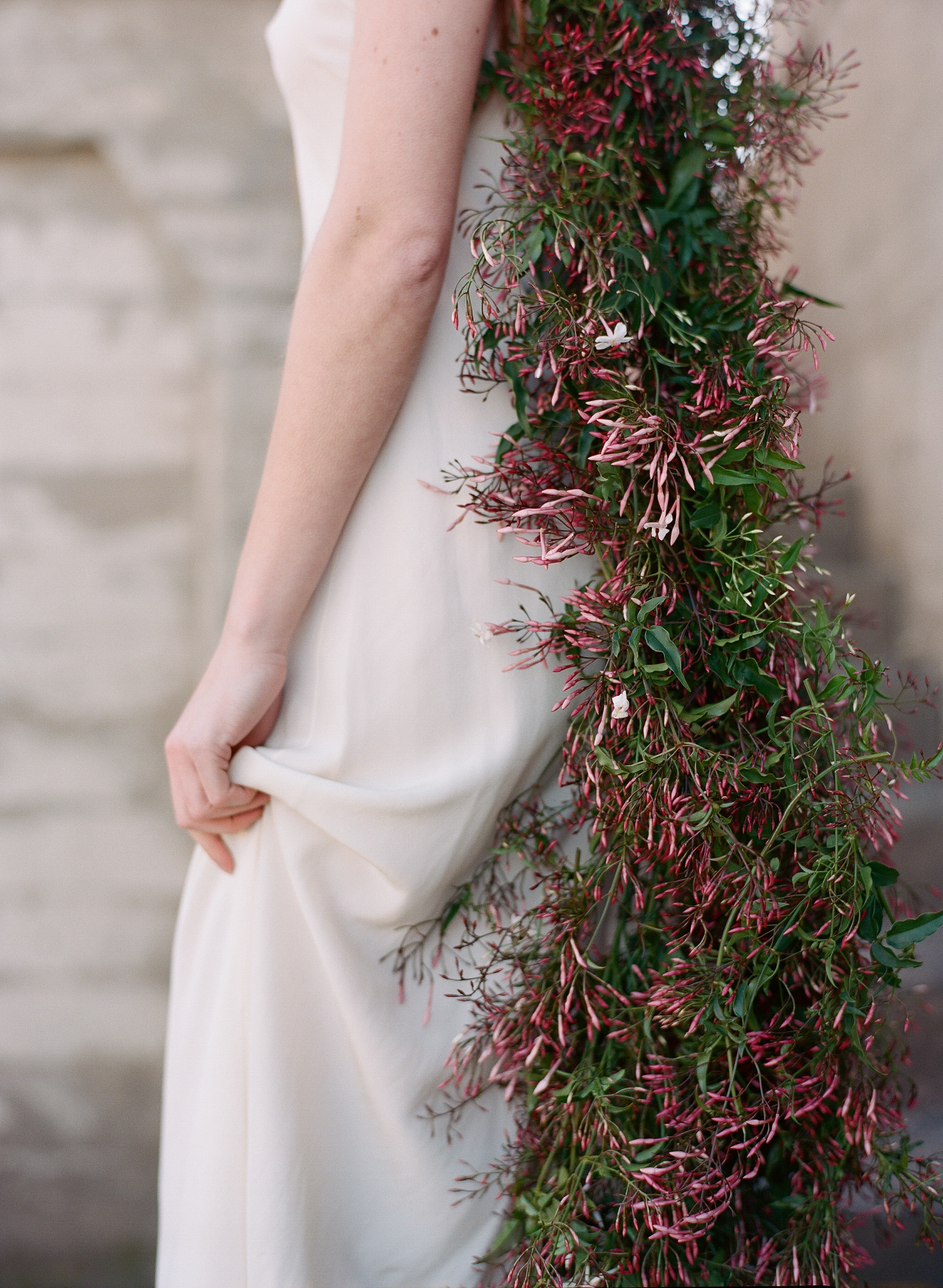 The bride's jasmine garland hangs down her back; Sylvie Gil Photography