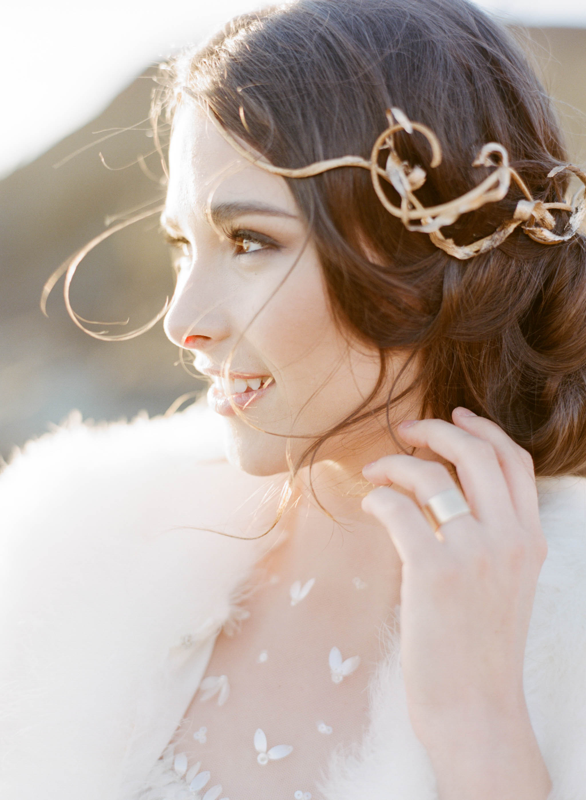 A nautical bride with a wrought gold headpiece at sunset; Sylvie Gil Photography