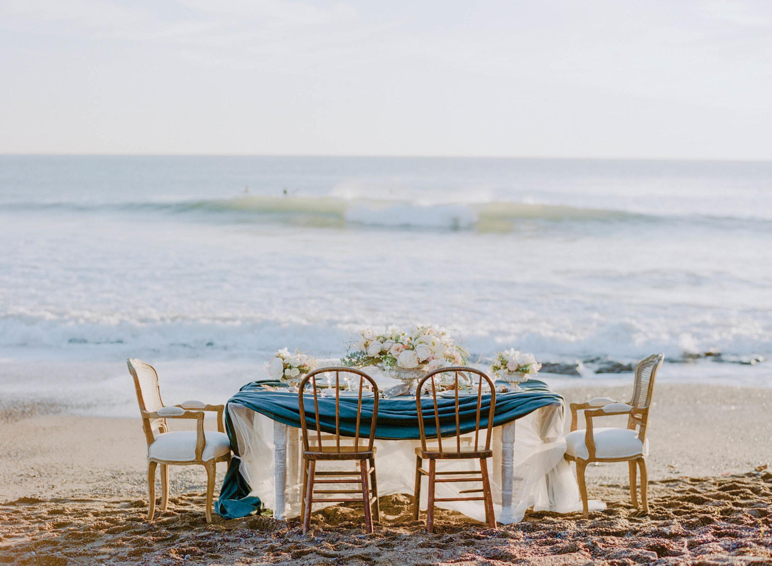 An intimate nautical reception table arranged on a California beach; Sylvie Gil Photography