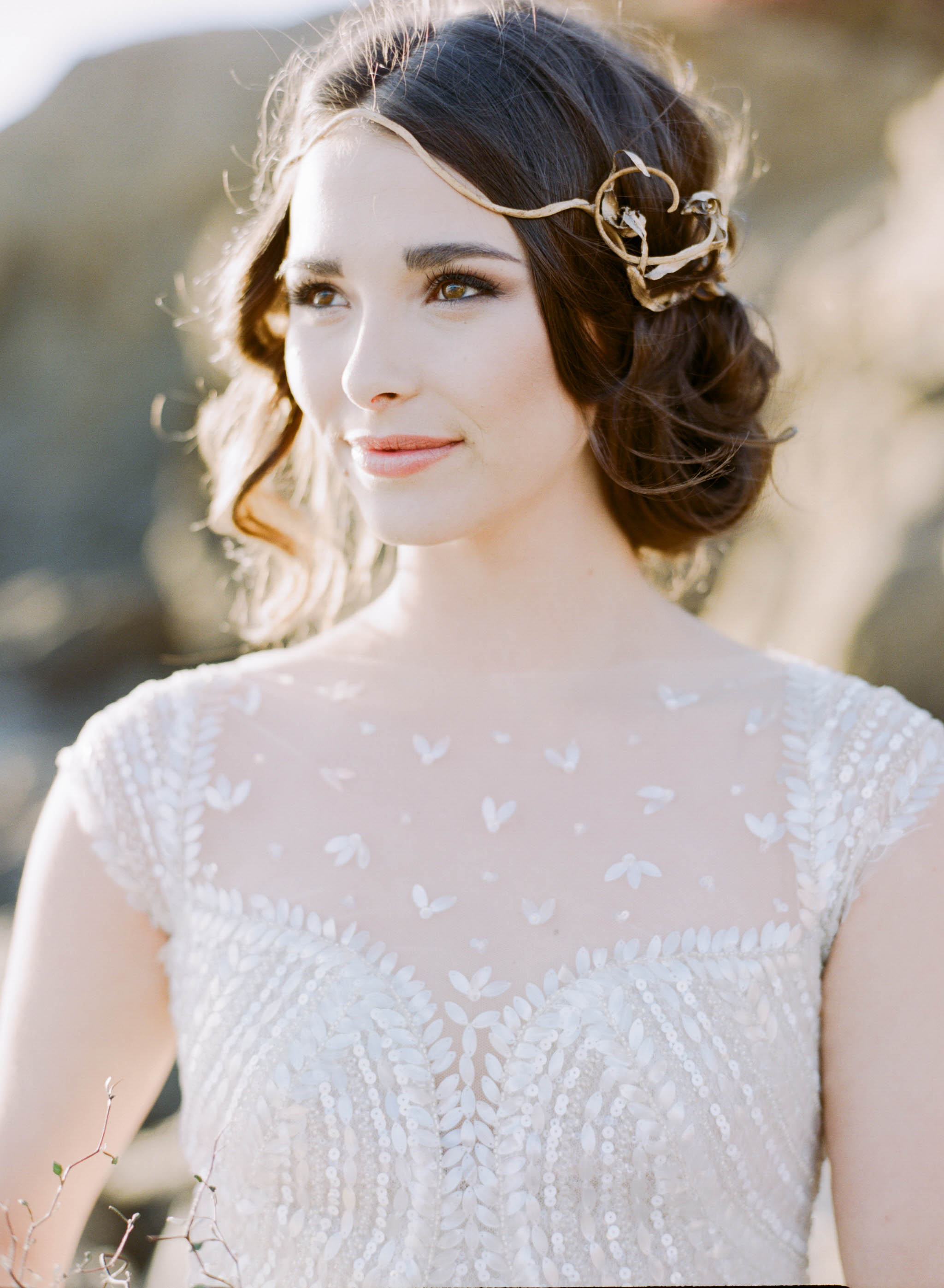 A bride with a wrought gold headpiece in a 1920's art deco gown on a California beach; Sylvie Gil Photography