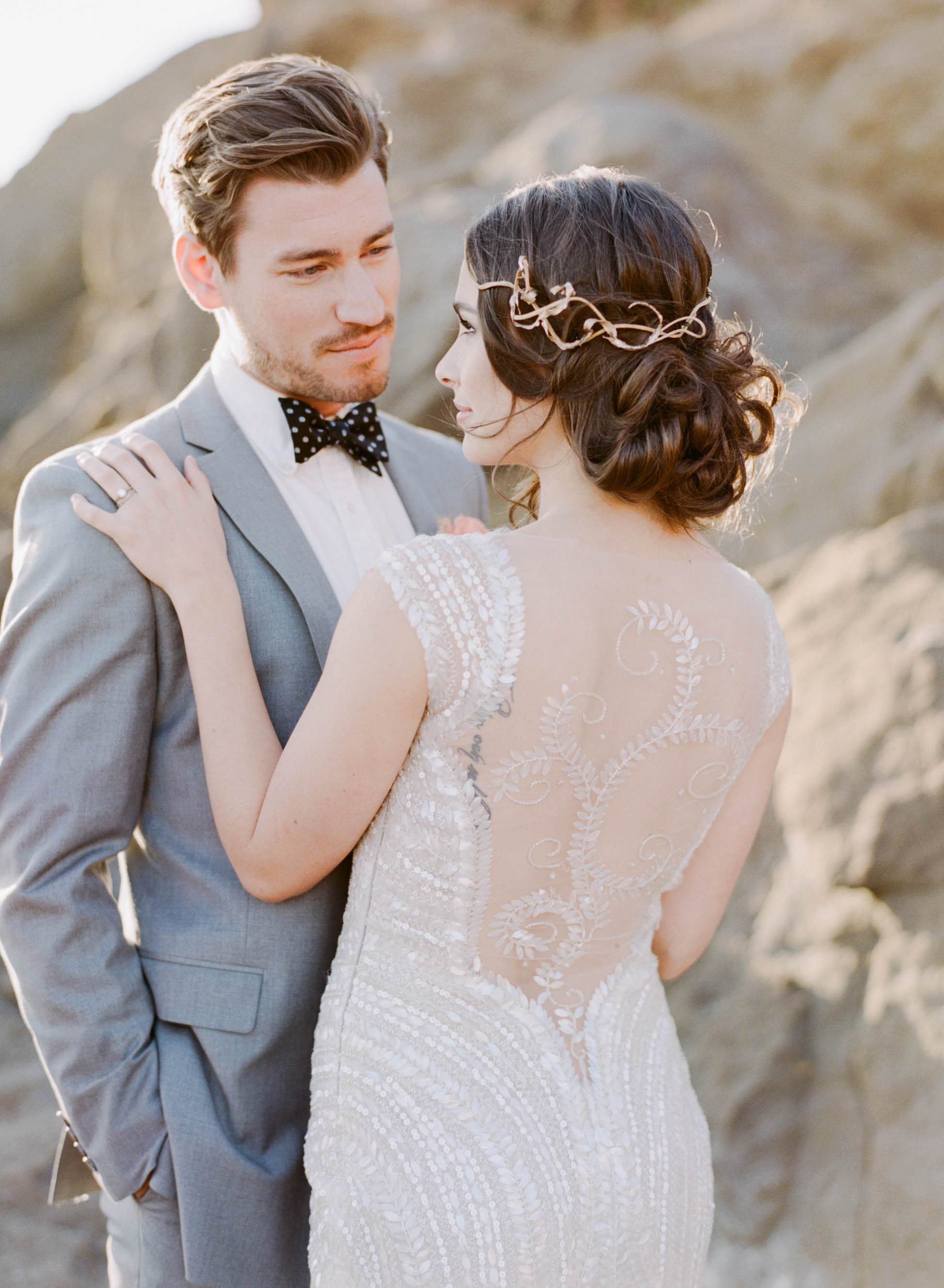 A sunset couple session on a California beach, the bride wears a sequined 1920's gown; Sylvie Gil Photography