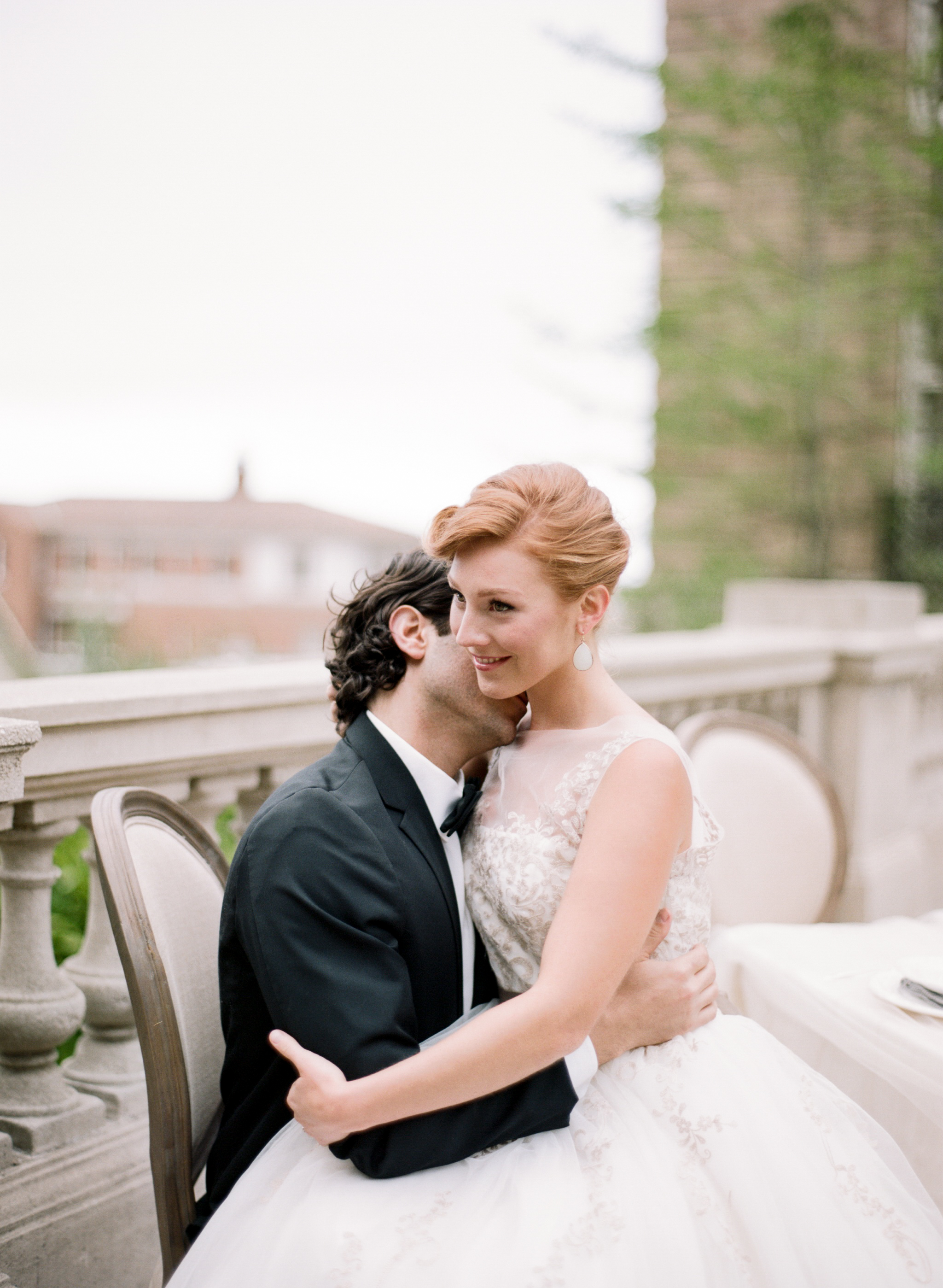 A groom kisses his bride's neck at an intimate wedding reception at the Lyon Steps in San Francisco; Sylvie Gil Photography