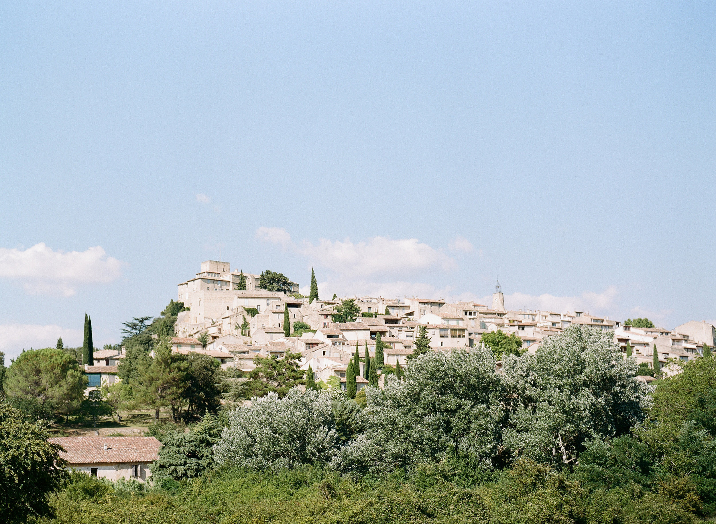 A view of a village on a hill in Provence, France; Sylvie Gil Photography