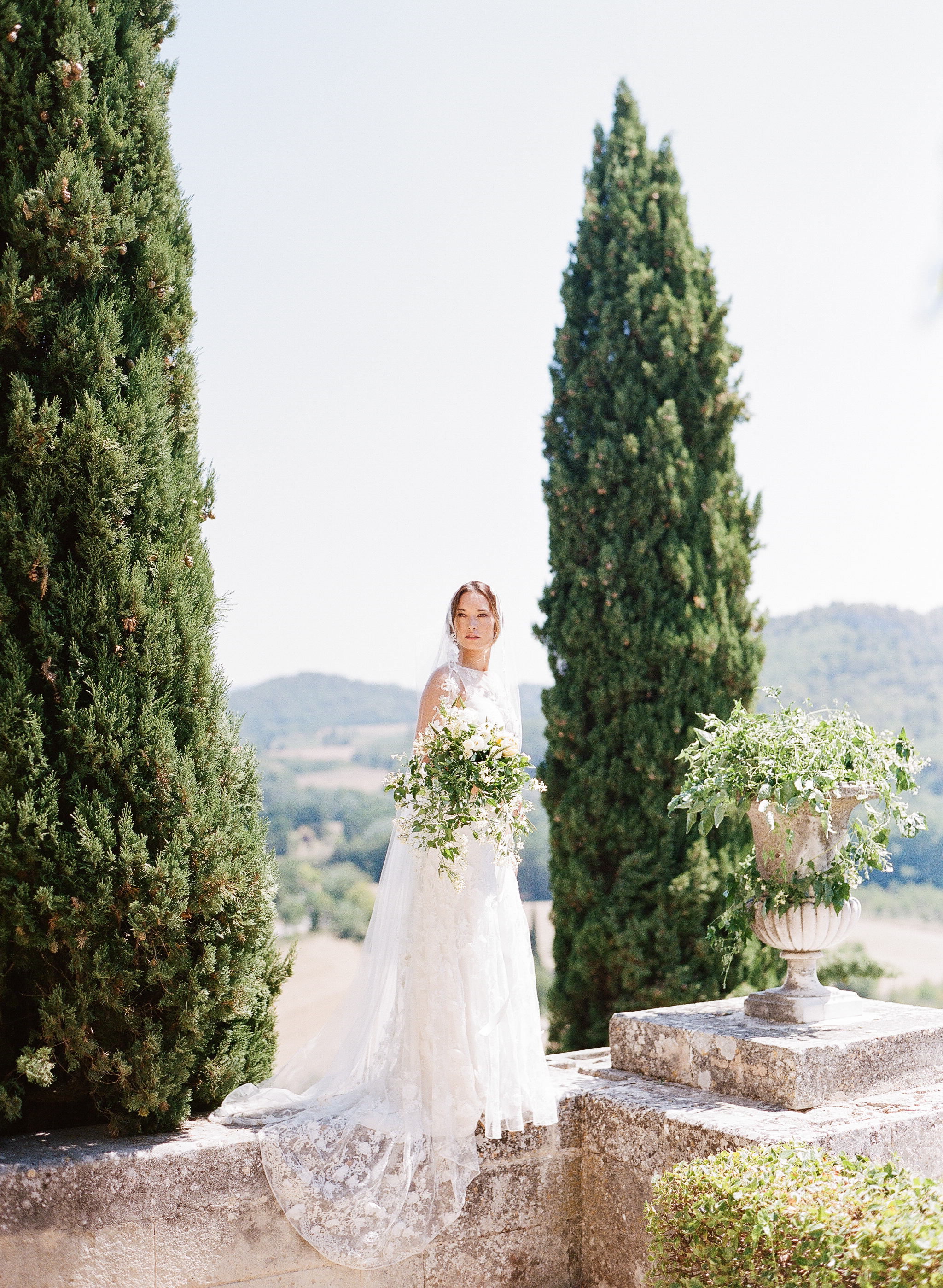 A bride on a wall in chateau in Provence, France; Sylvie Gil Photography