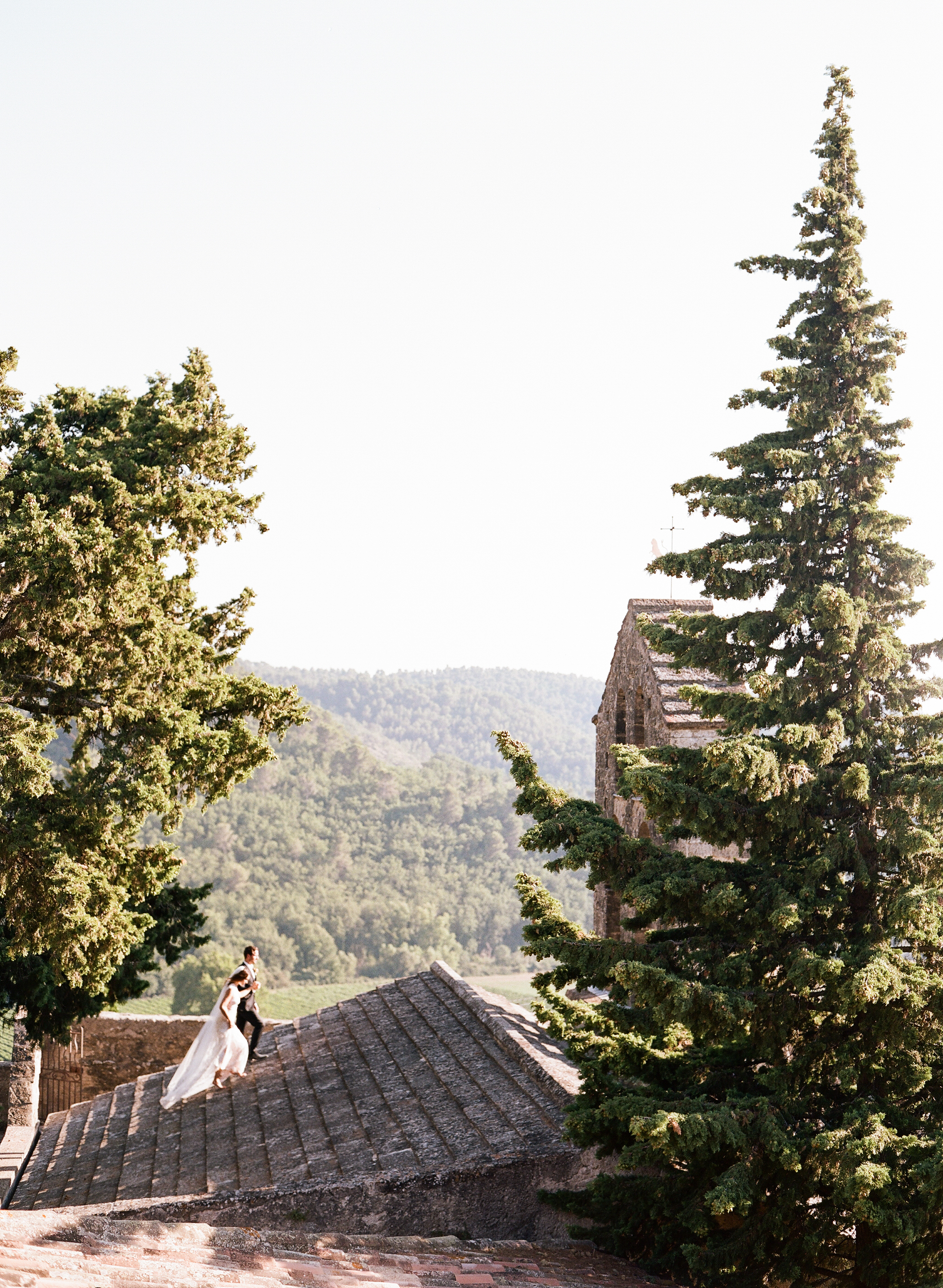A bride and groom couple session on a village rooftop in Provence, France; Sylvie Gil Photography