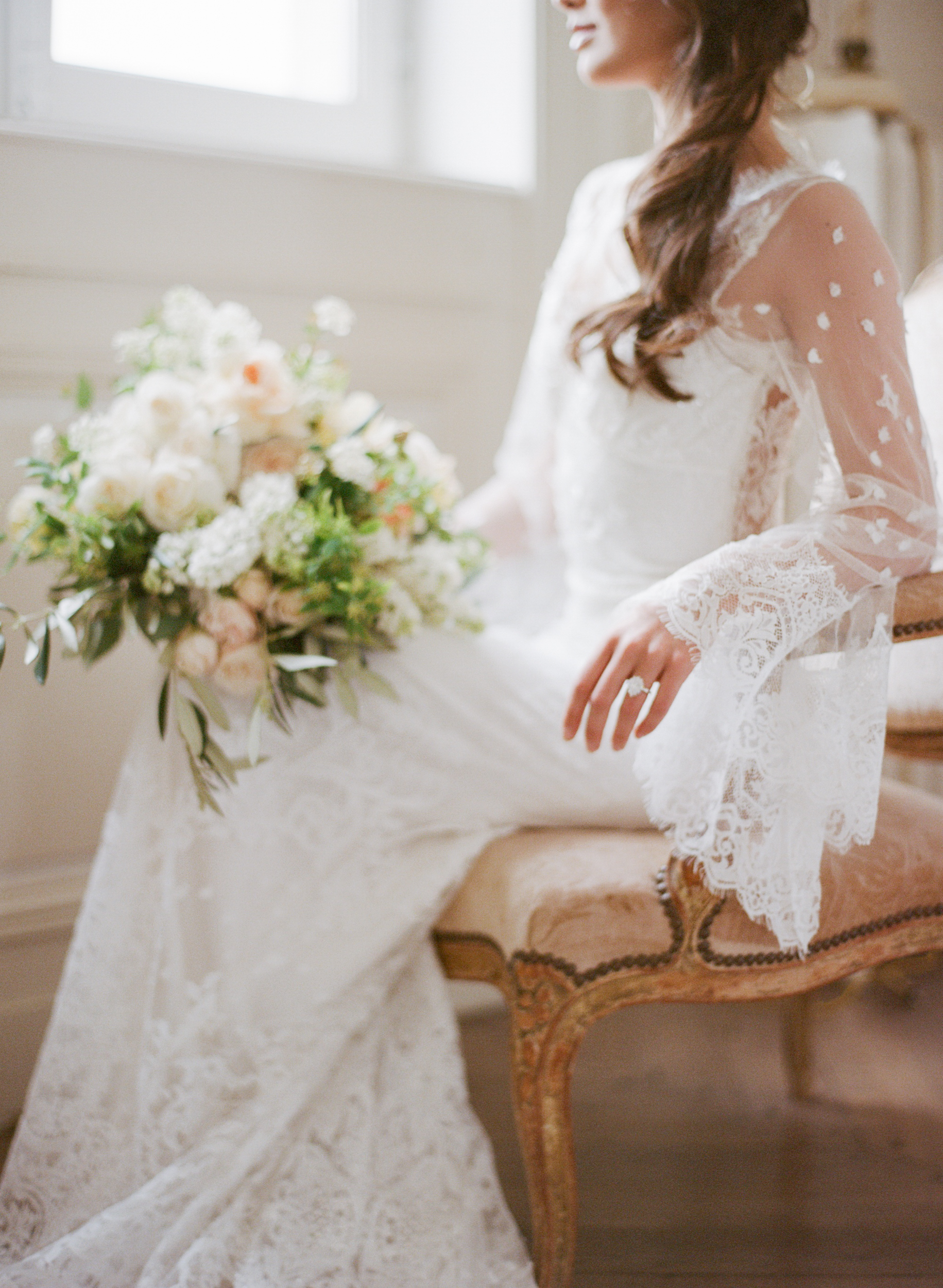 A bride in a flowy lace gown at Chateau de Varennes; Sylvie Gil Photography