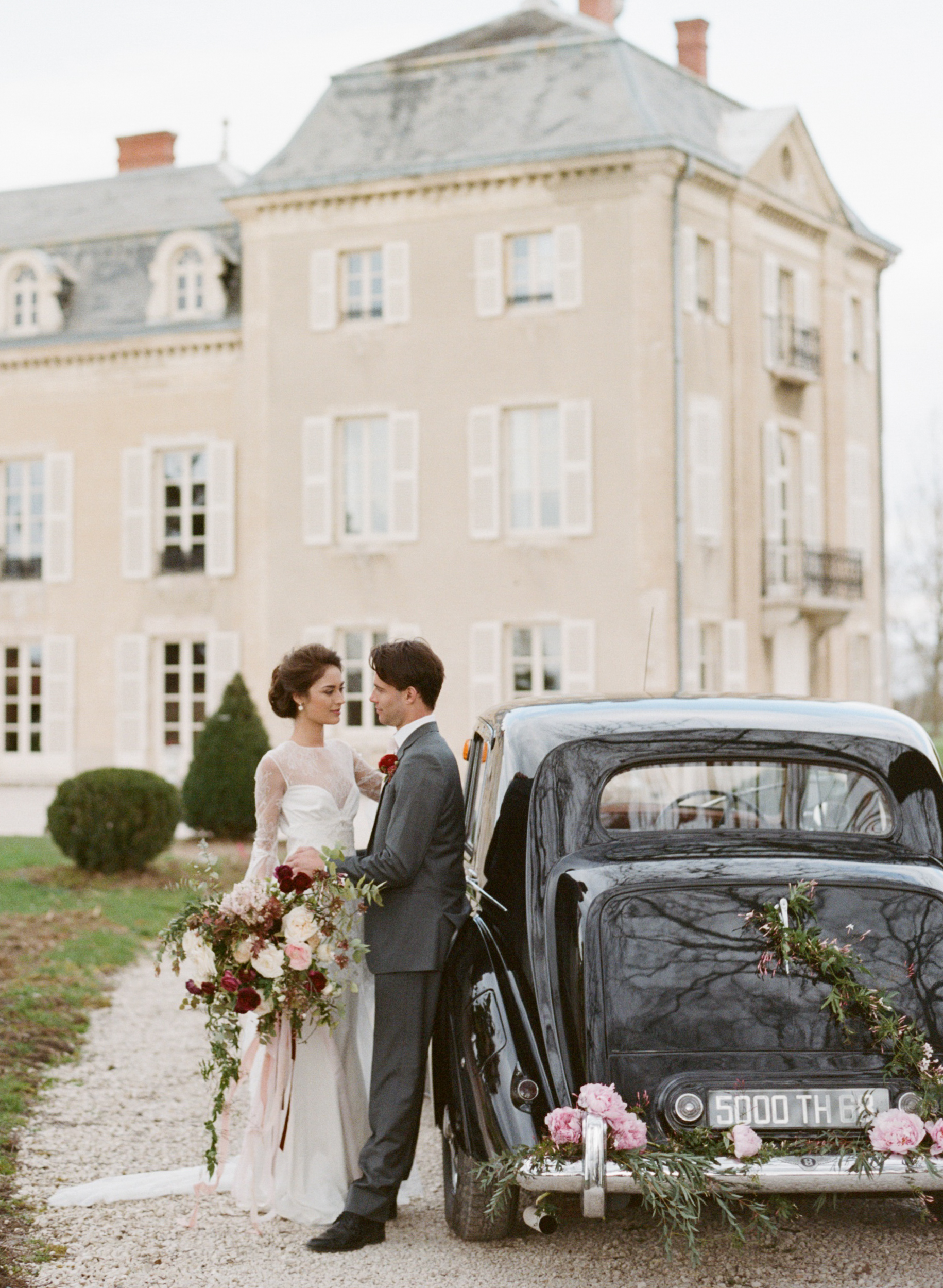 A bride and groom kiss after their wedding at a chapel in Burgundy, France; Sylvie Gil Photography