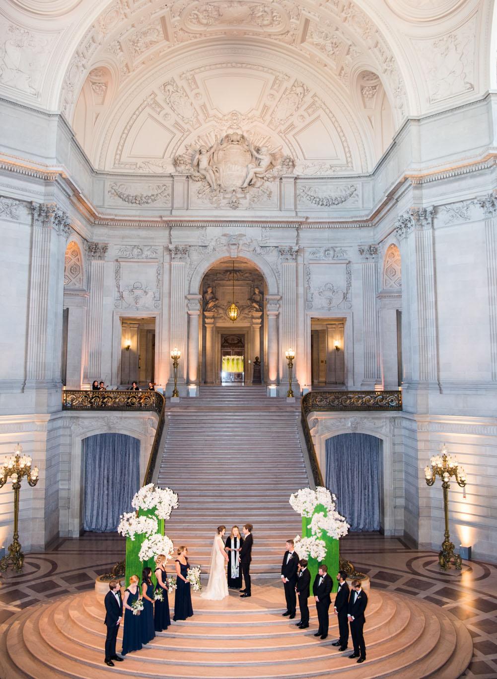 A wedding ceremony in the atrium of San Francisco City Hall; Sylvie Gil Photography