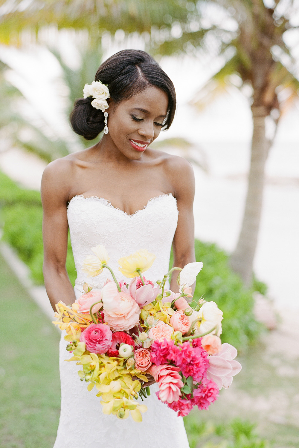 The bride in a sweetheart neckline gown and tropical flower bouquet; Sylvie Gil Photography