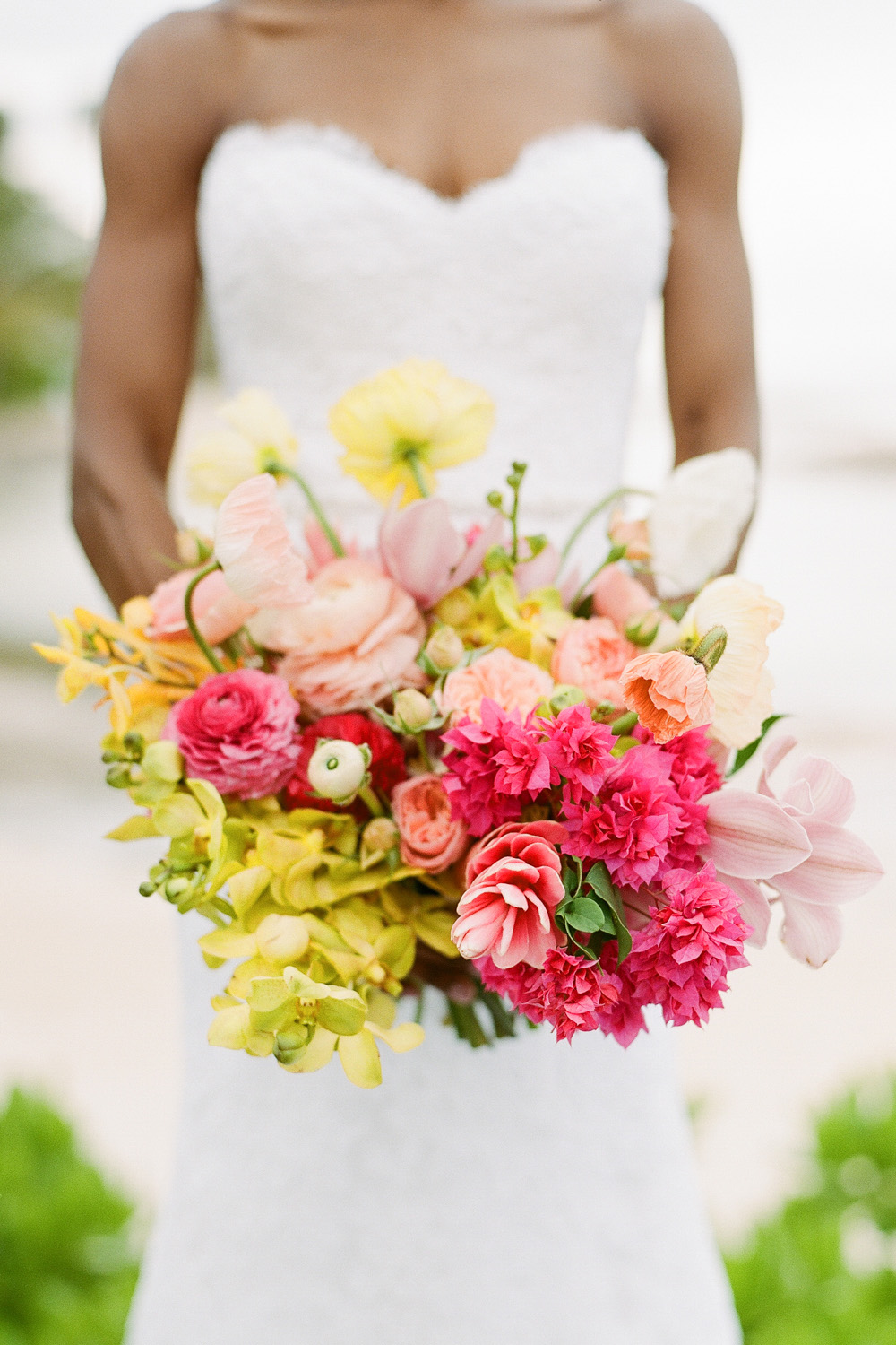 Tropical orchids and lilies in a bouquet for a beach wedding in Montego Bay; Sylvie Gil Photography