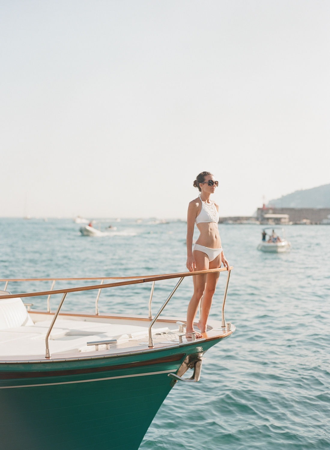 The bride looks out off a yacht in Positano on the Amalfi Coast; Sylvie Gil Photography