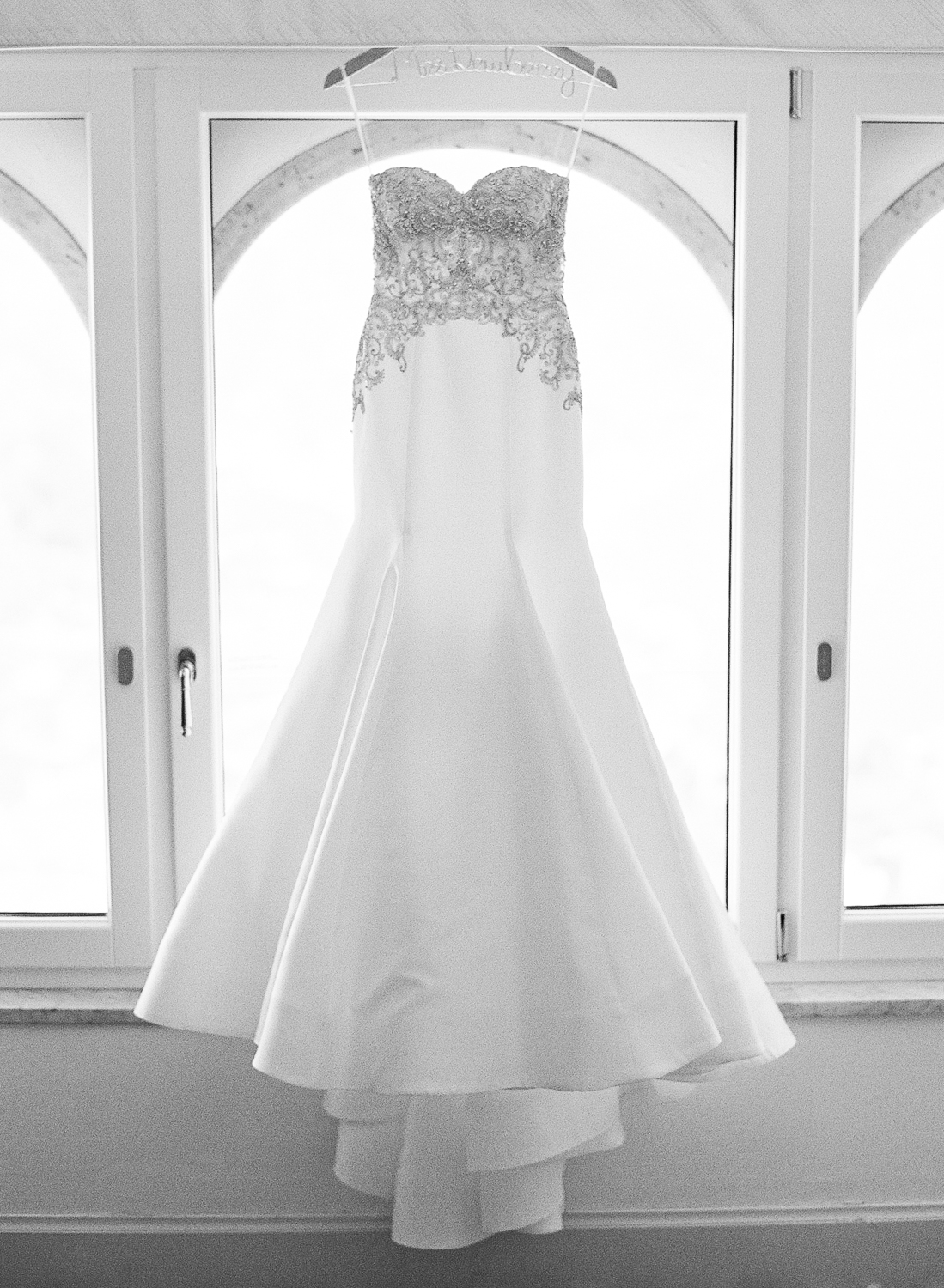 The bride's gown hangs in the window of Hotel Belmond Caruso in Ravello, Italy; Sylvie Gil Photography