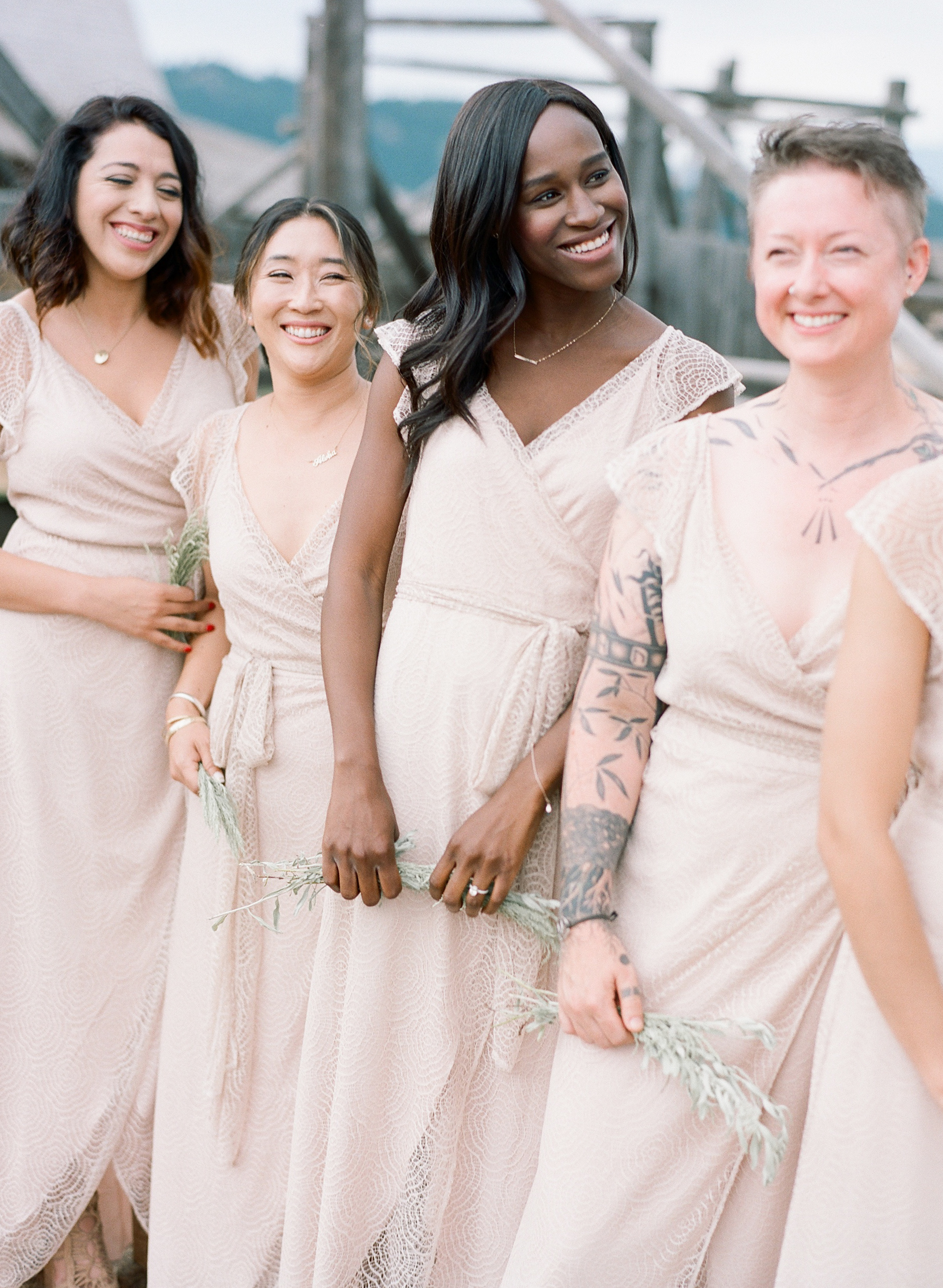 Bridesmaids in blush gowns, diverse wedding, tattoo bridesmaid, Sylvie Gil Photography