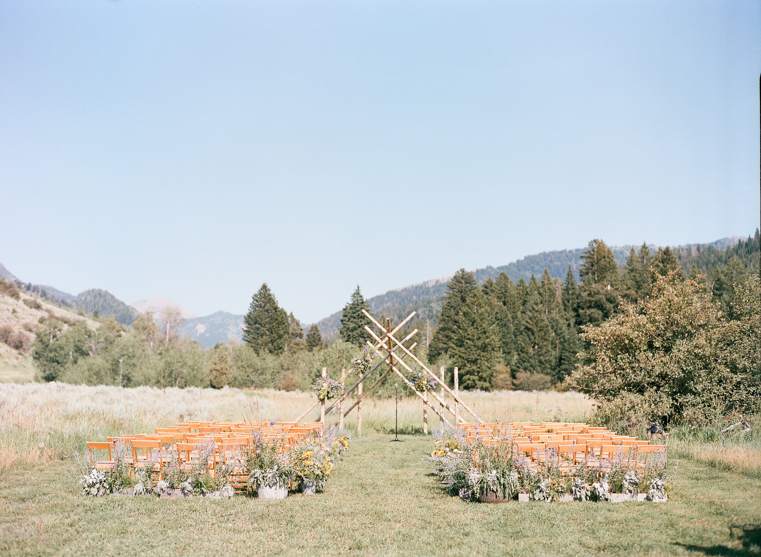 Country wedding ceremony, Wyoming wedding, wildflower decor, Sylvie Gil Photography