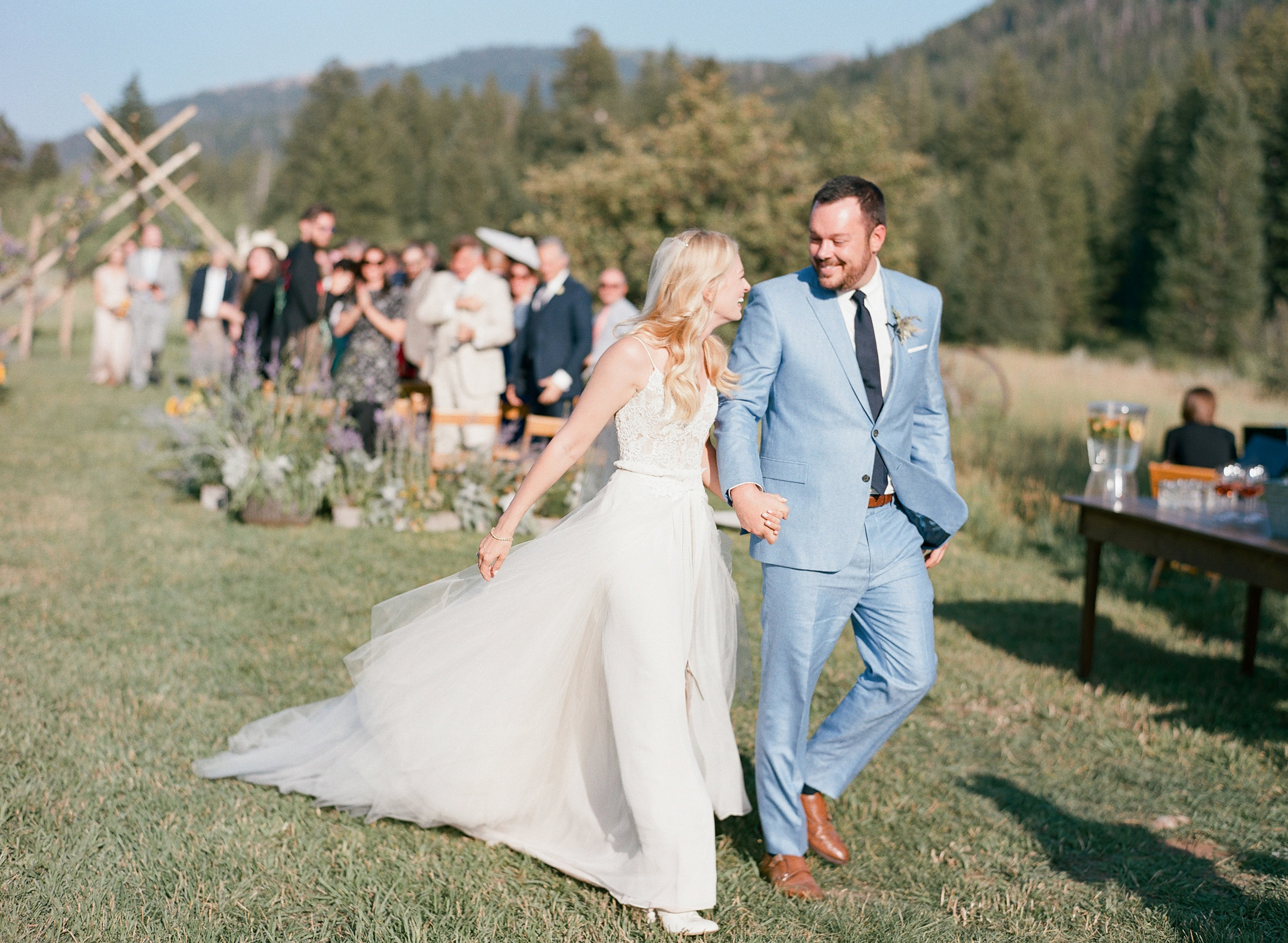 Happy hollywood couple just married in wyoming leaving the ceremony, Sylvie Gil Photography