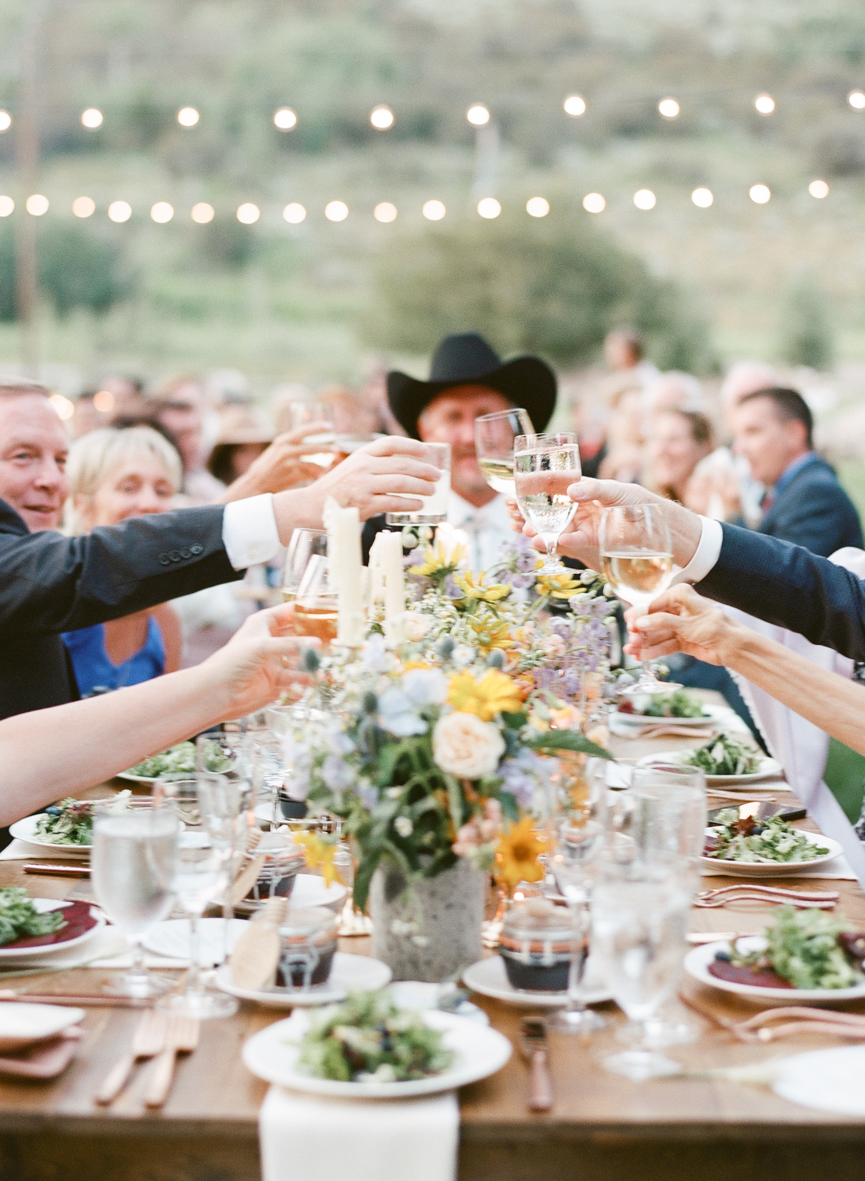 cowboy guests cheers the new hollywood couple under twinkling lights, Sylvie Gil Photography