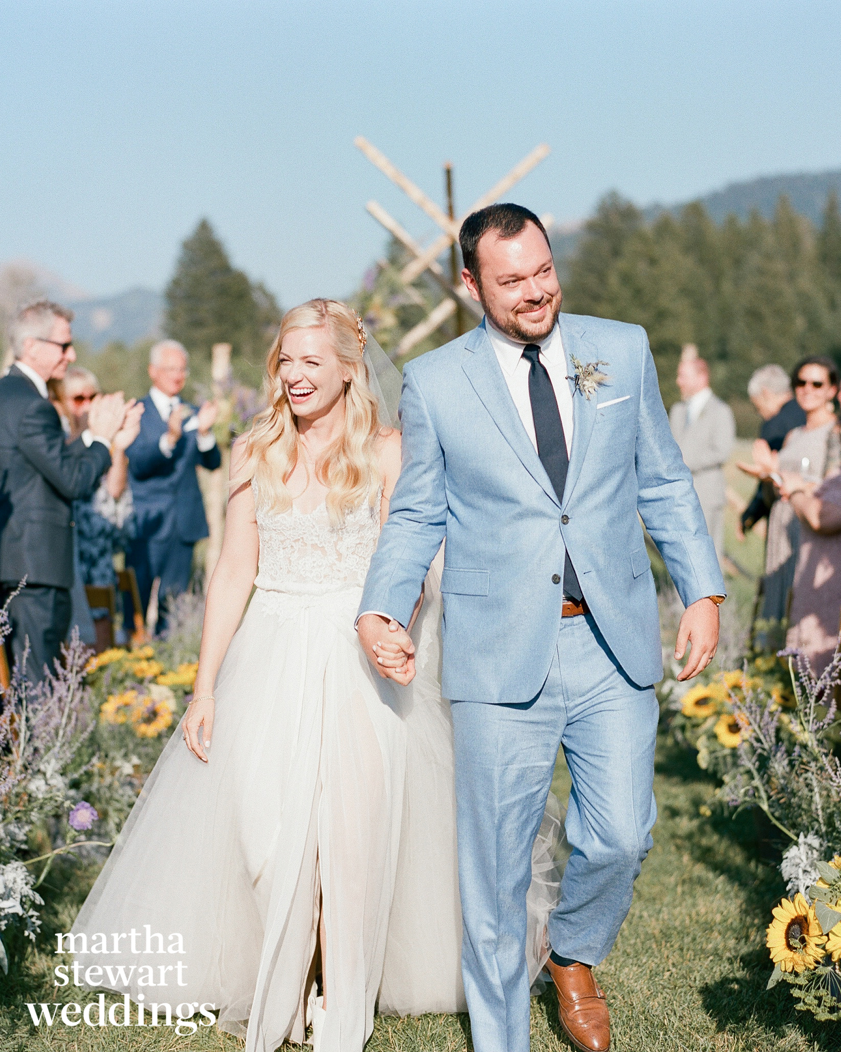 Emotional couple just married, leaving the altar in wyoming country wedding, Sylvie Gil Photography