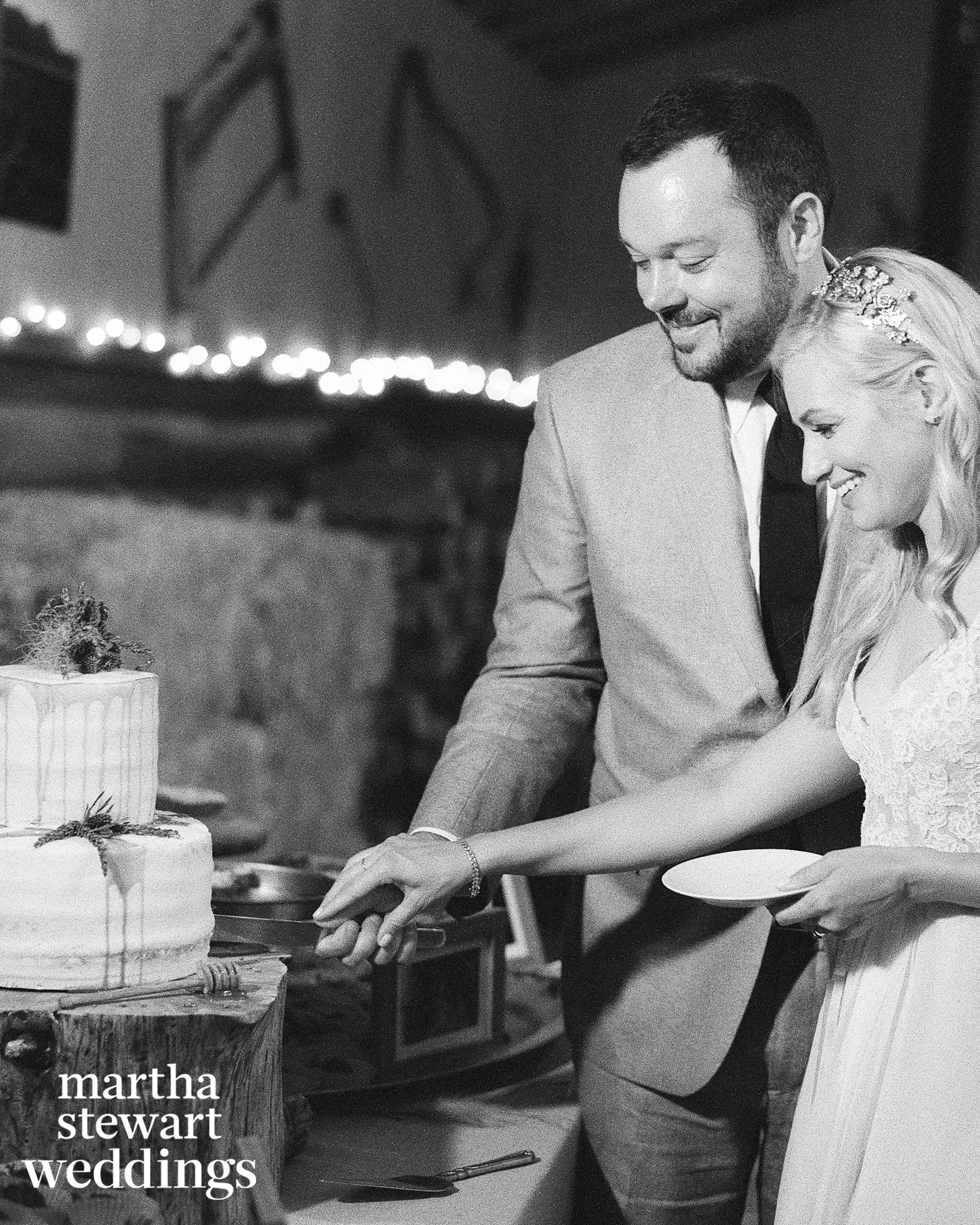 Famous couple cuts the cake for their wedding in a barn in wyoming, Sylvie Gil Photography