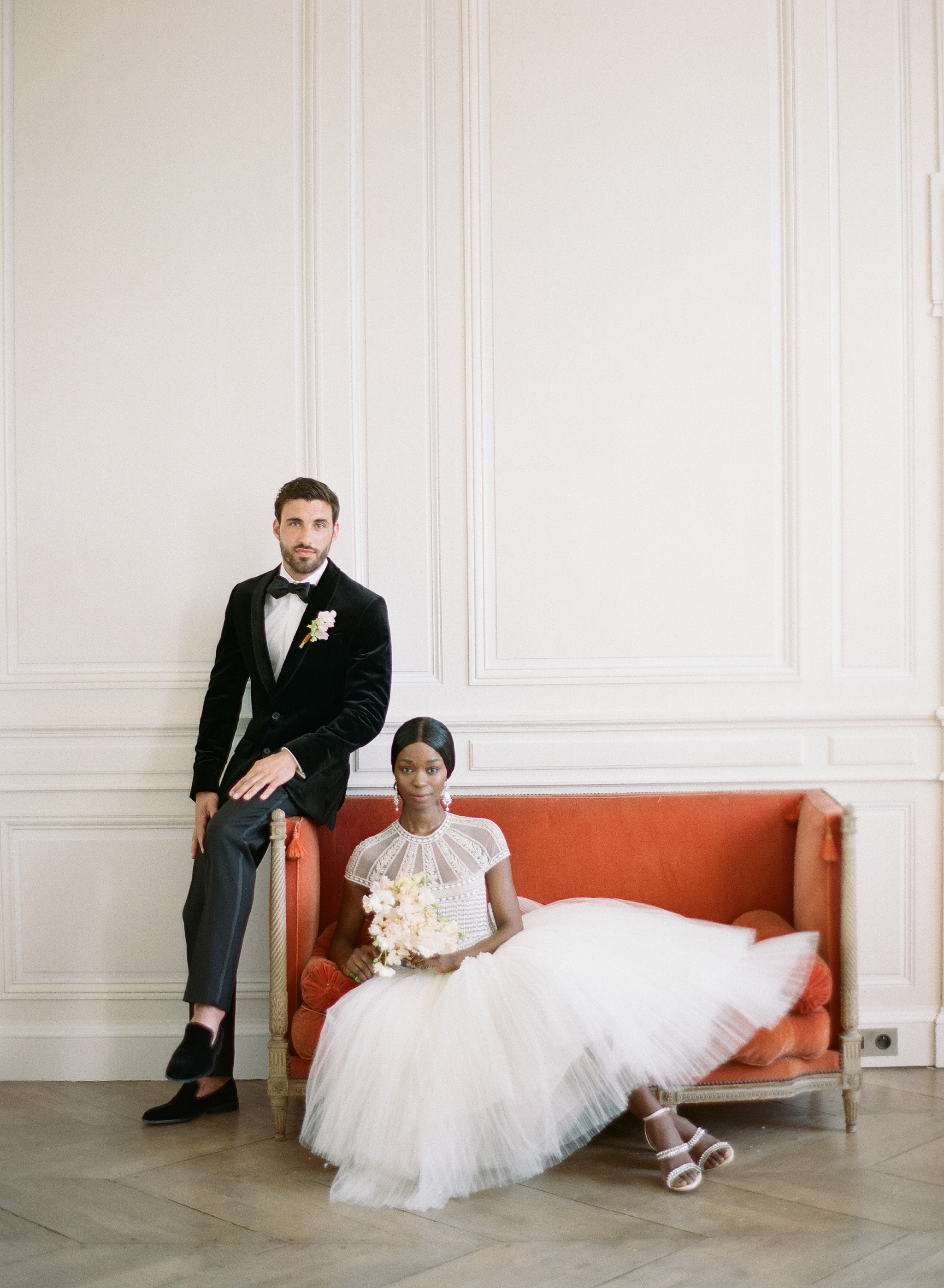 A bride and groom pose at Chateau de Varennes in Burgundy, France; Sylvie Gil Photography