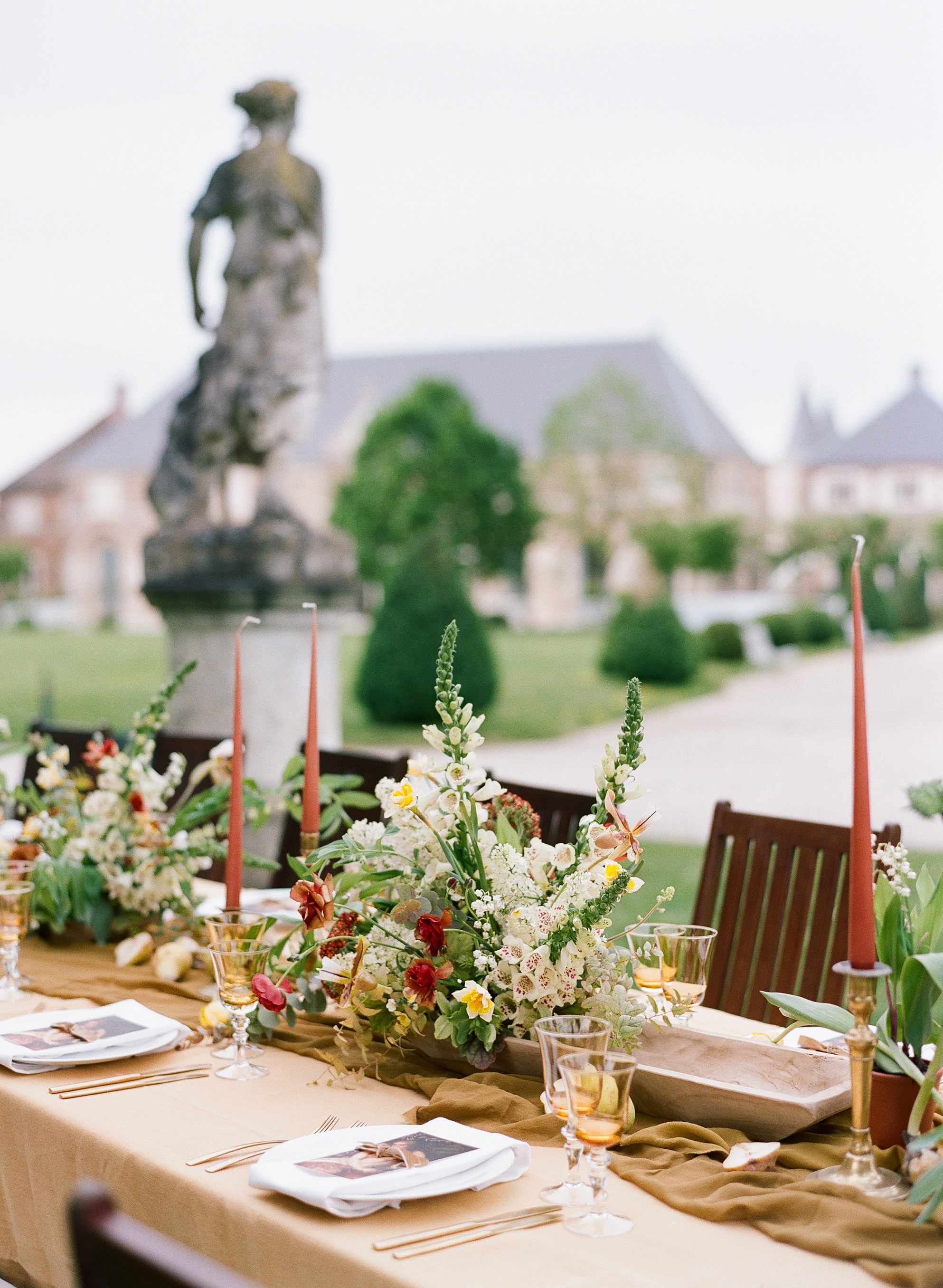 A richly colored wedding reception table at Chateau de Varennes in Burgundy, France; Sylvie Gil Photography