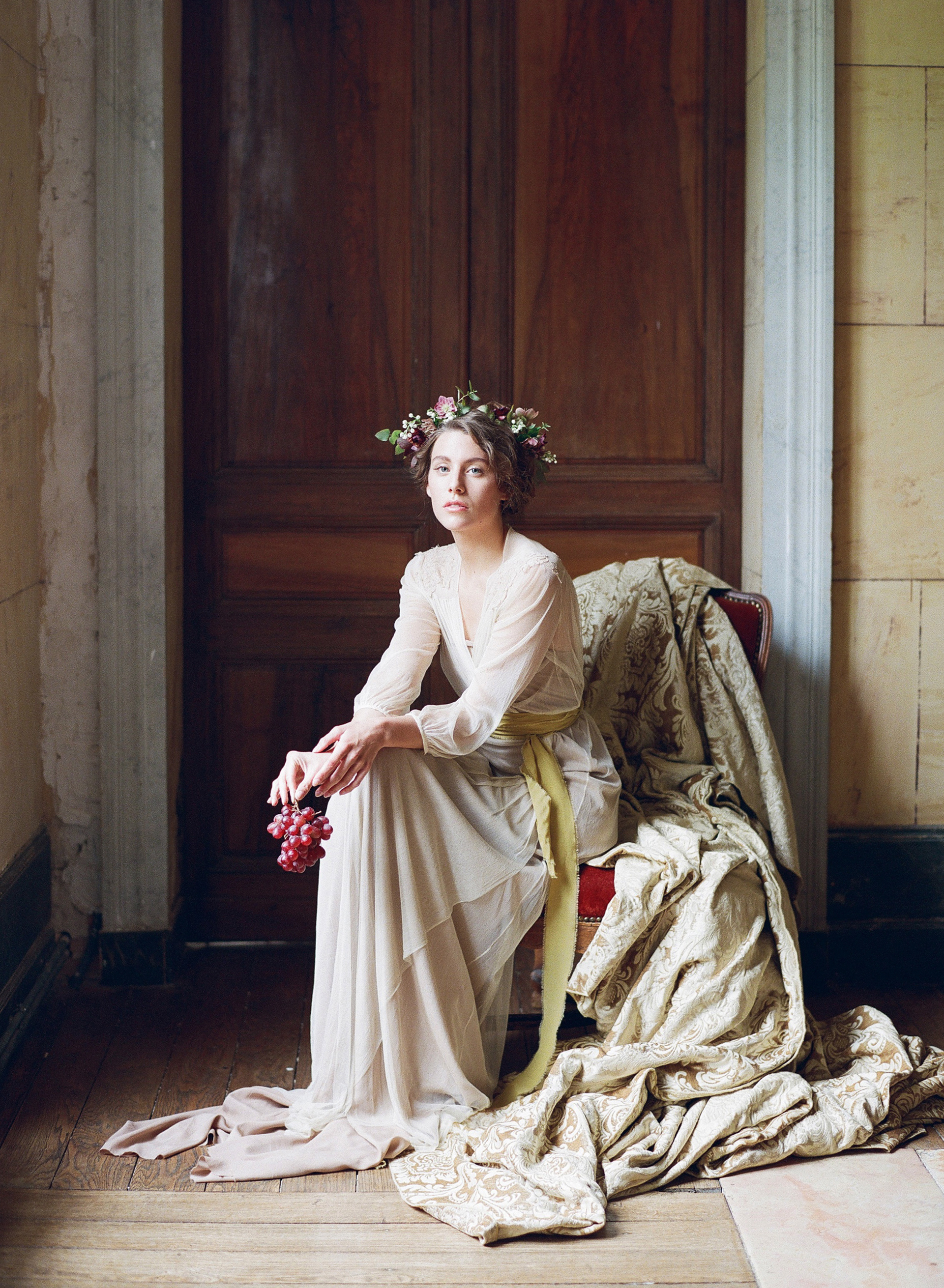 A picturesque bride in chiffon boudoir pieces, posed in Chateau de Varennes in Burgundy; Sylvie Gil Photography