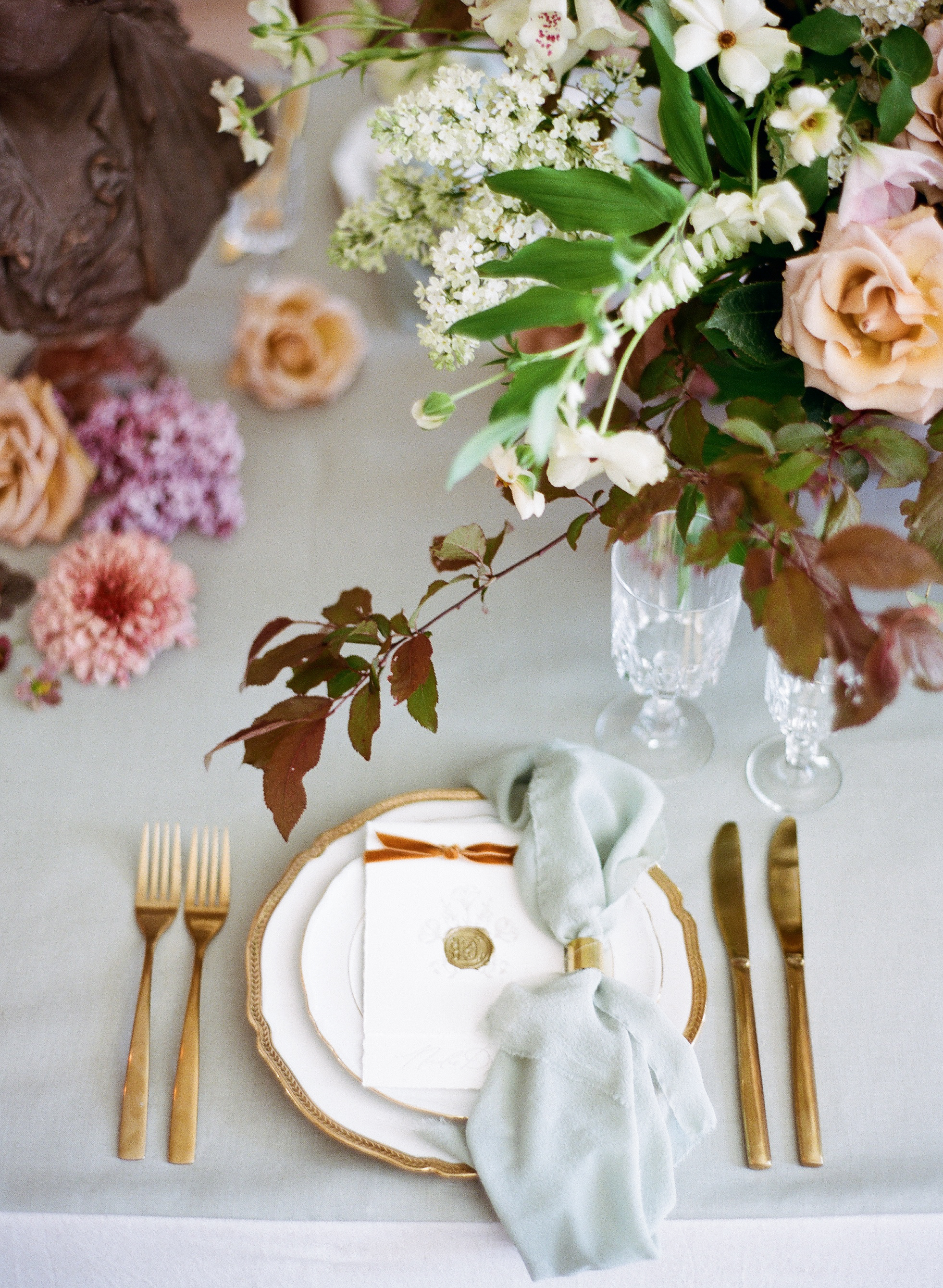 Muted table settings decorate a reception table in Chateau de Varennes in Burgundy; Sylvie Gil Photography