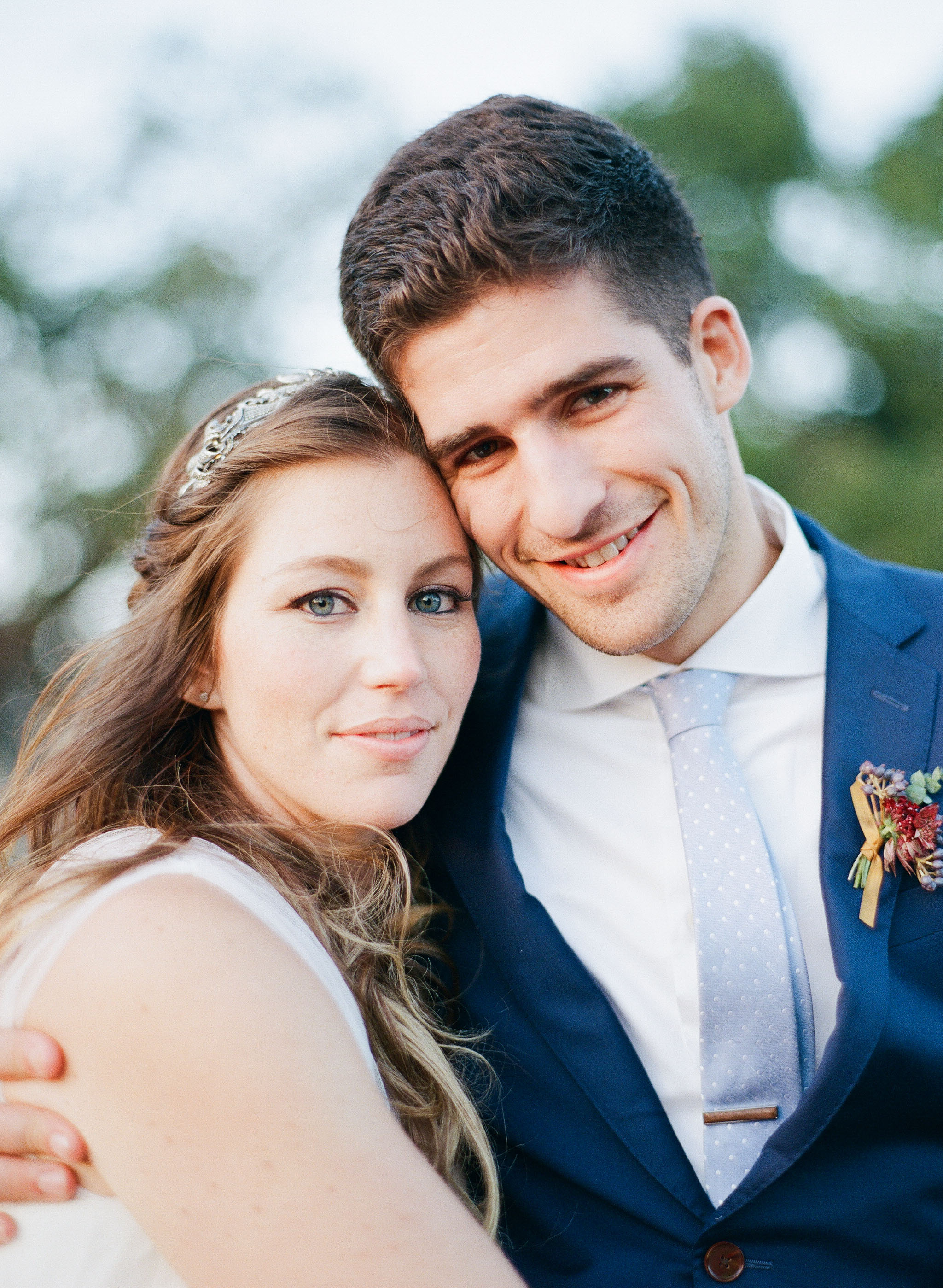 A portrait of bride and groom in Napa Valley; Sylvie Gil Photography
