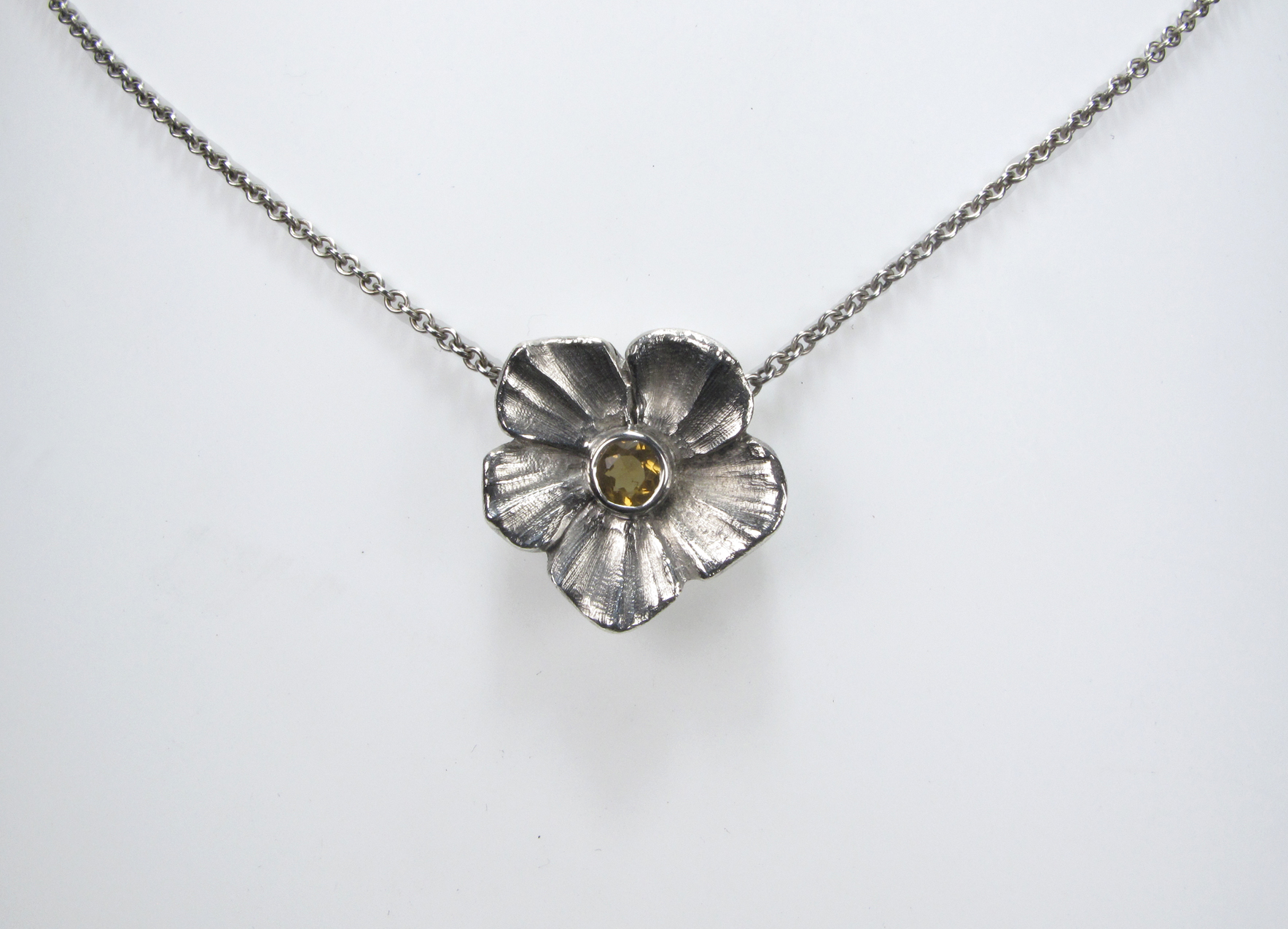 silver flower with citrine.jpg