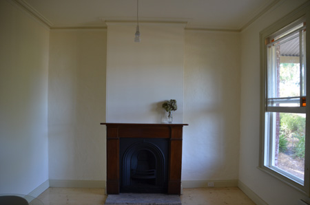 Coleman Architects: restored fireplace in front bedroom