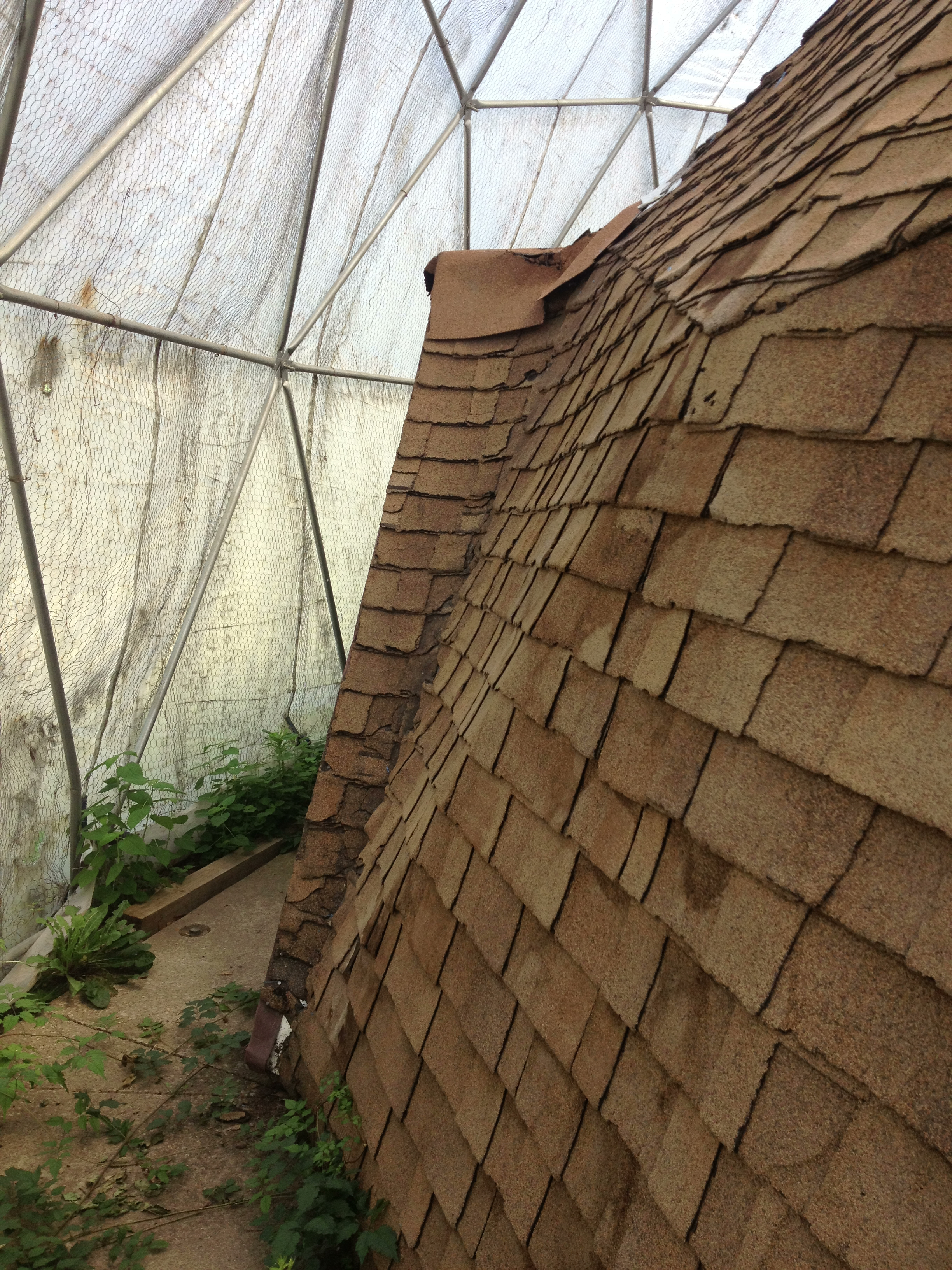 The shingles were in bad shape, and the foundation slab was cracked all over the place.