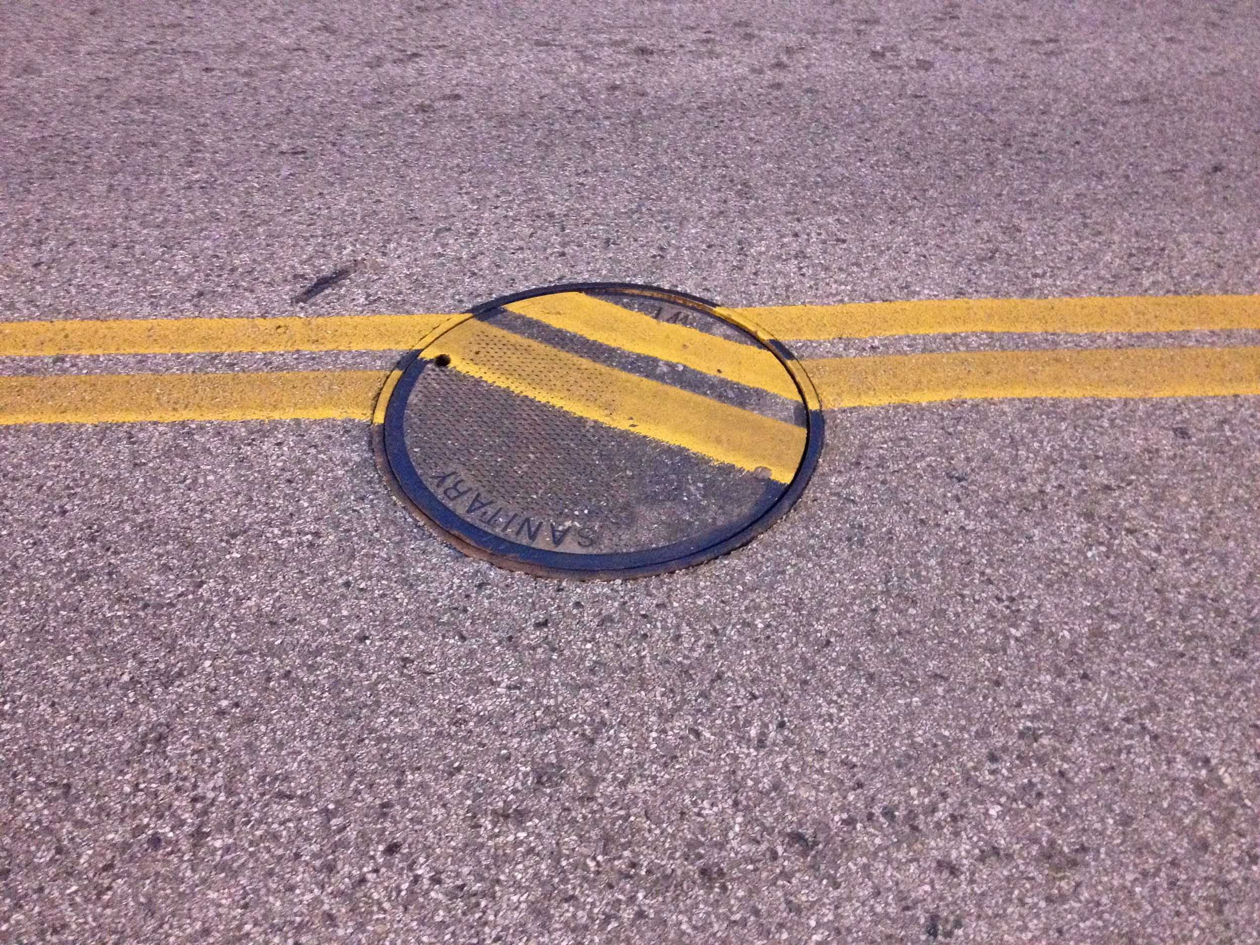 Mr. Duchamp would be quite proud of the sanitation worker who replaced this manhole.
