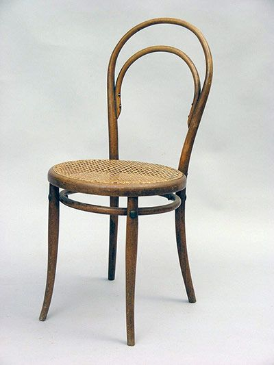 An original Chair No. 14 with wicker seat.