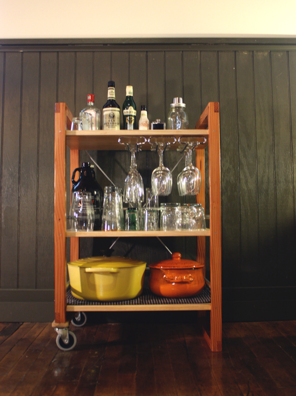 The wineglass holder is available off-the-shelf at Home Depot.