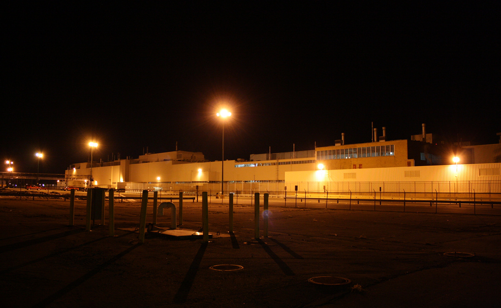 Photo of the Flint Truck and Bus Plant at night, circa 2011,  by Flickr user Joseph Dennis .