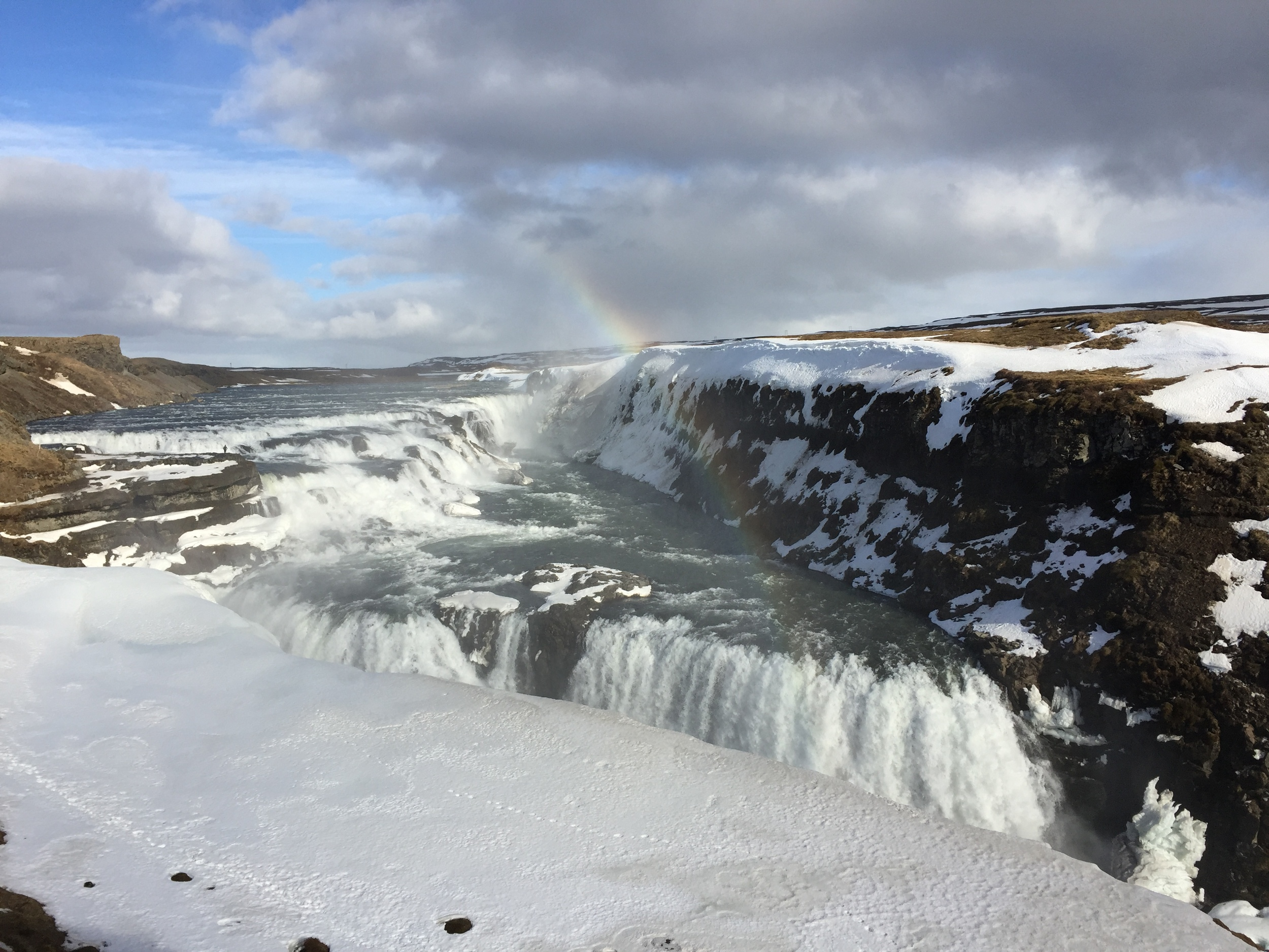 Gullfoss, one of the largest waterfalls in the world, replete with rainbow. Photo does not do the scale of the thing justice.