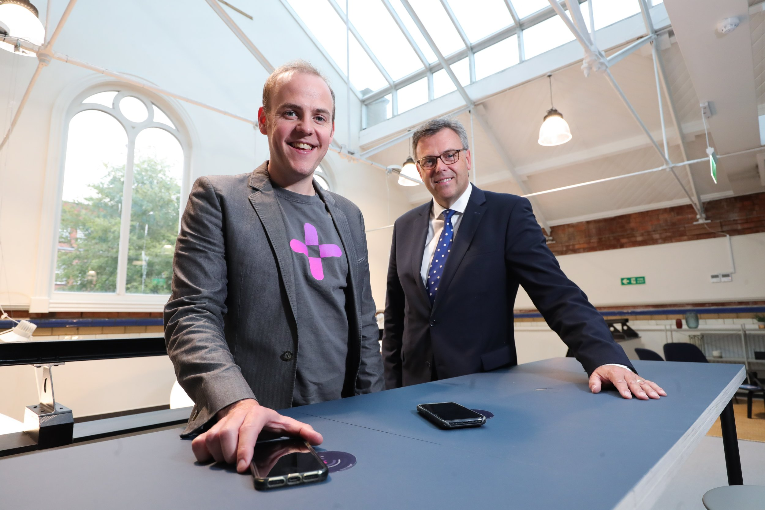 Chargifi CEO and co-founder Dan Bladen with CEO of Invest Northern Ireland, Alastair Hamilton.