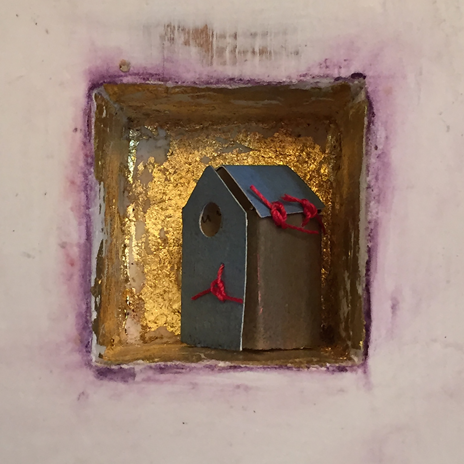 """Detail: Tiny Blue House . Limestone clay, acrylic, 24k gold leaf on board. Tiny house made from pastel painting. 5""""x5""""x2"""". $150."""