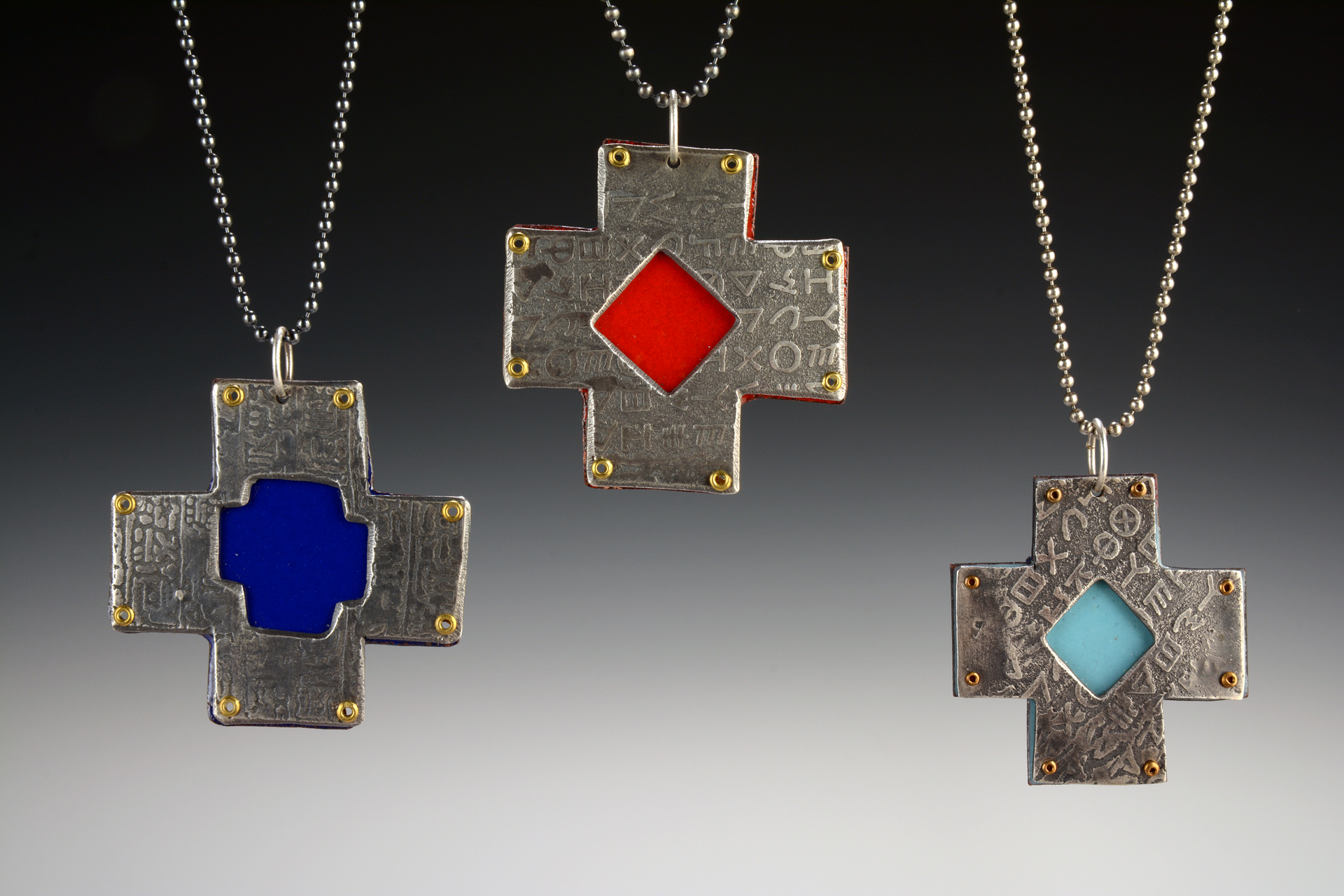 Cruciform pendants: Sterling silver and enameled copper.