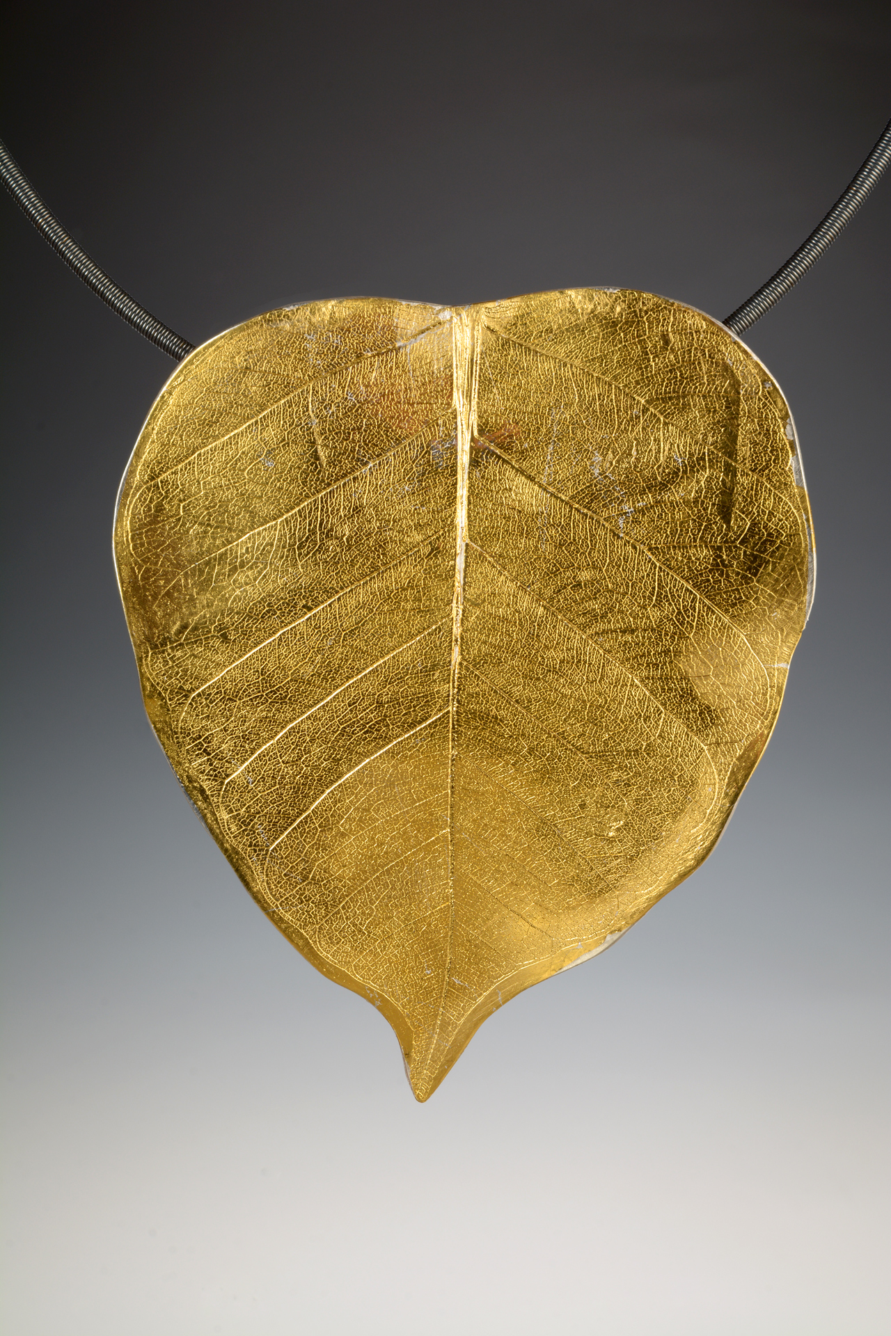 Sterling silver leaf pendant with 24k gold.